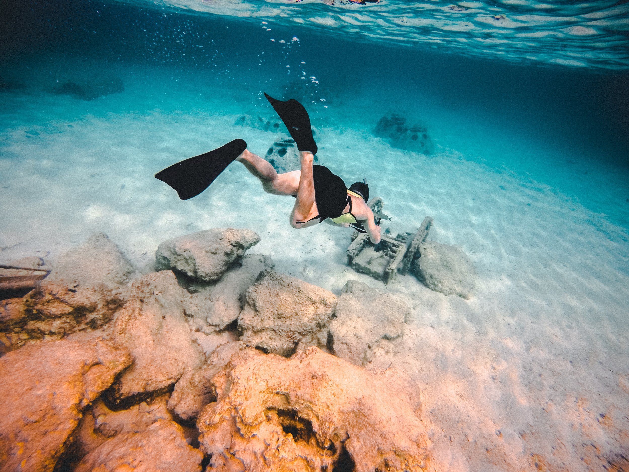 A diver exploring the crystal-clear waters of the Bahamas.