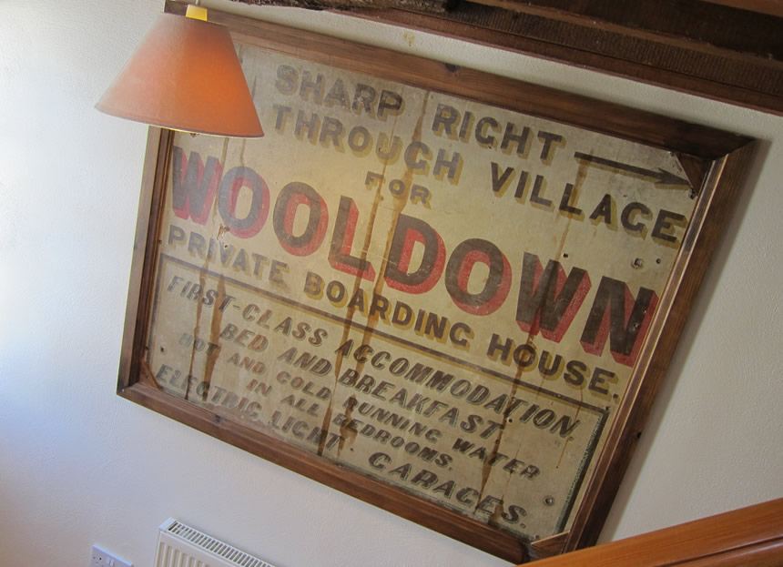 """Wooldown  Private Boarding House"" old sign from the A39 main road"