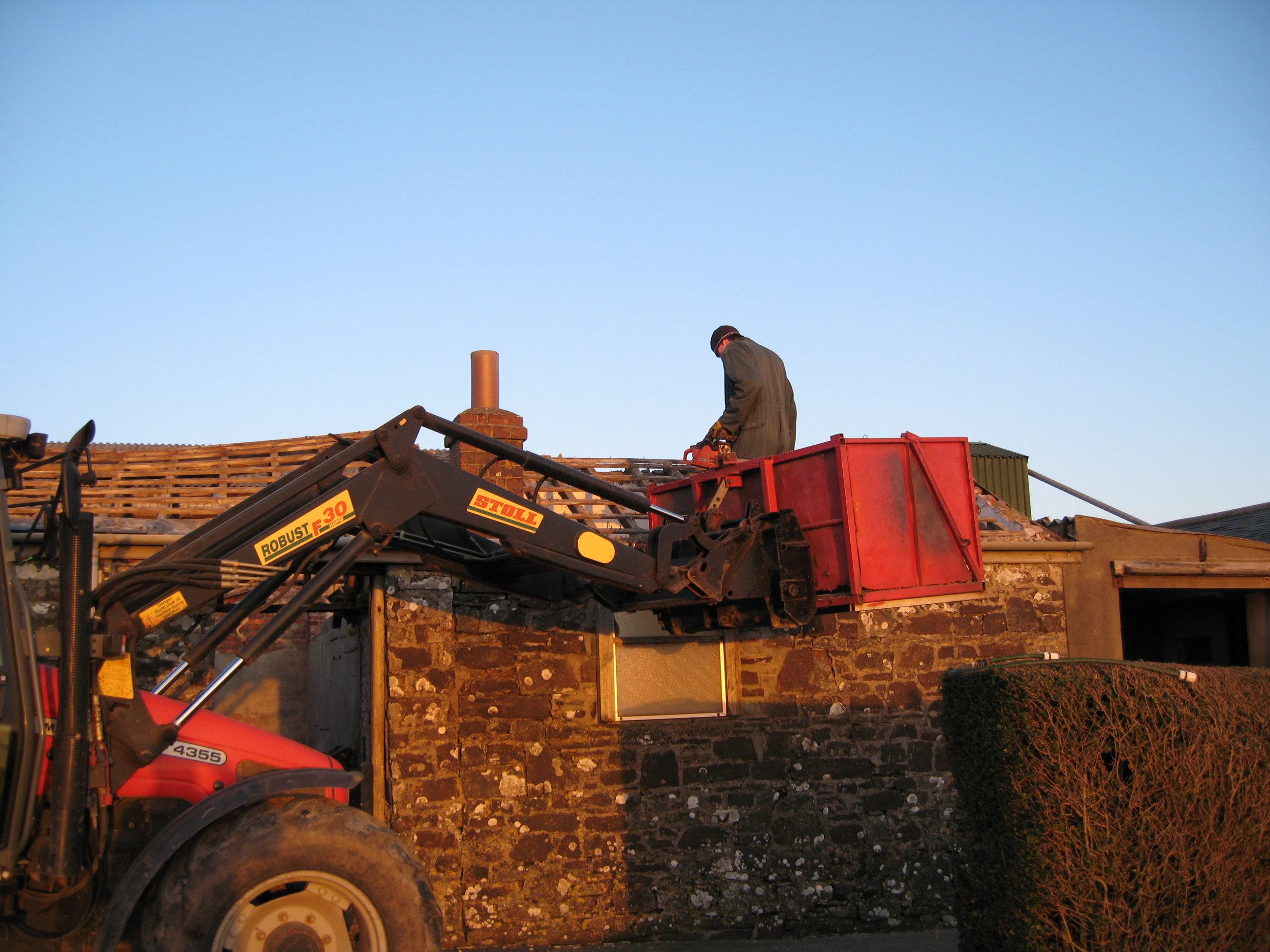 Ryan Blewett taking off the roof (now Dewdrop Dairy's bedroom window)