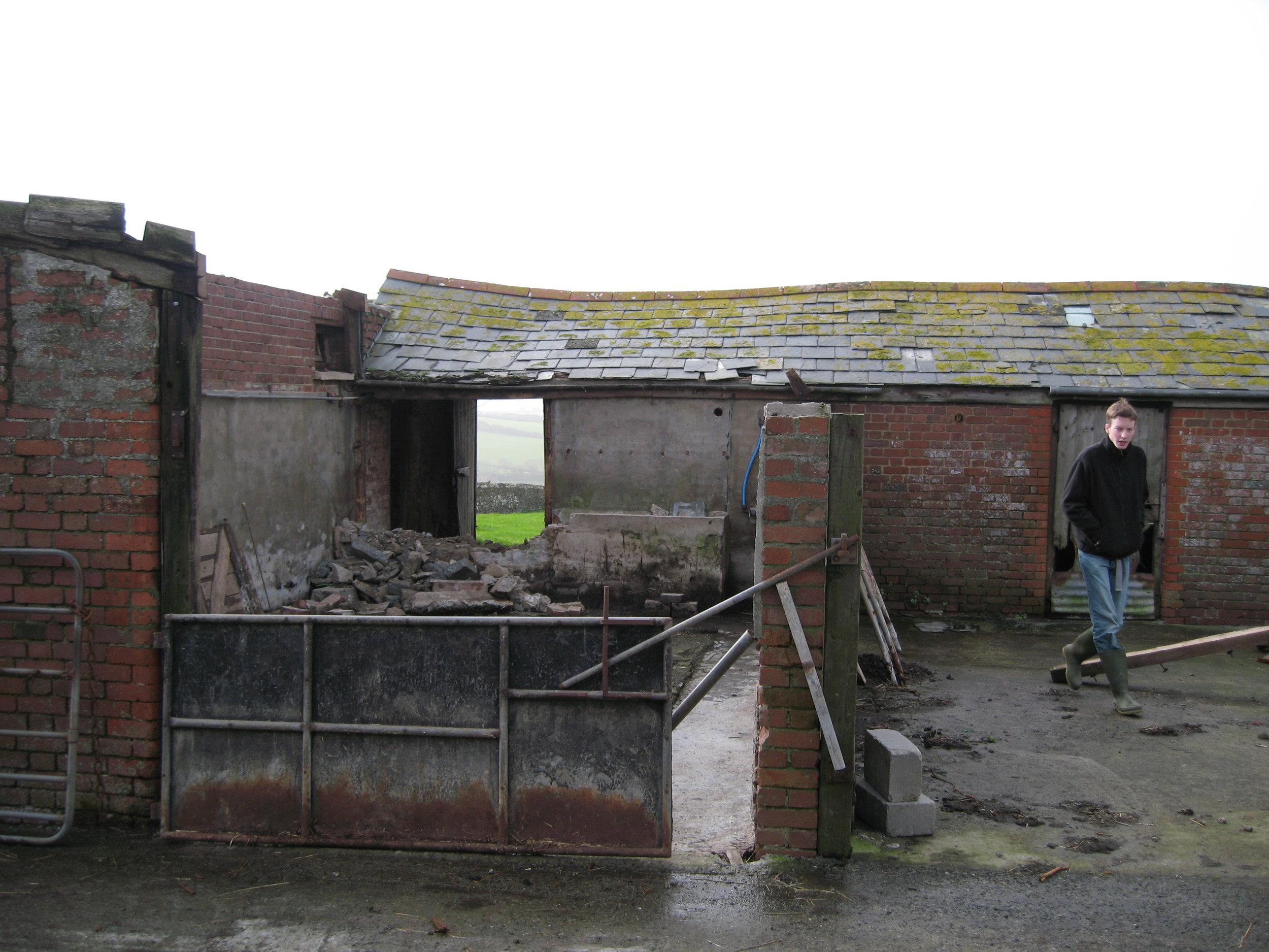 Rowan Blewett walking away from the site of Buttermilk Barn