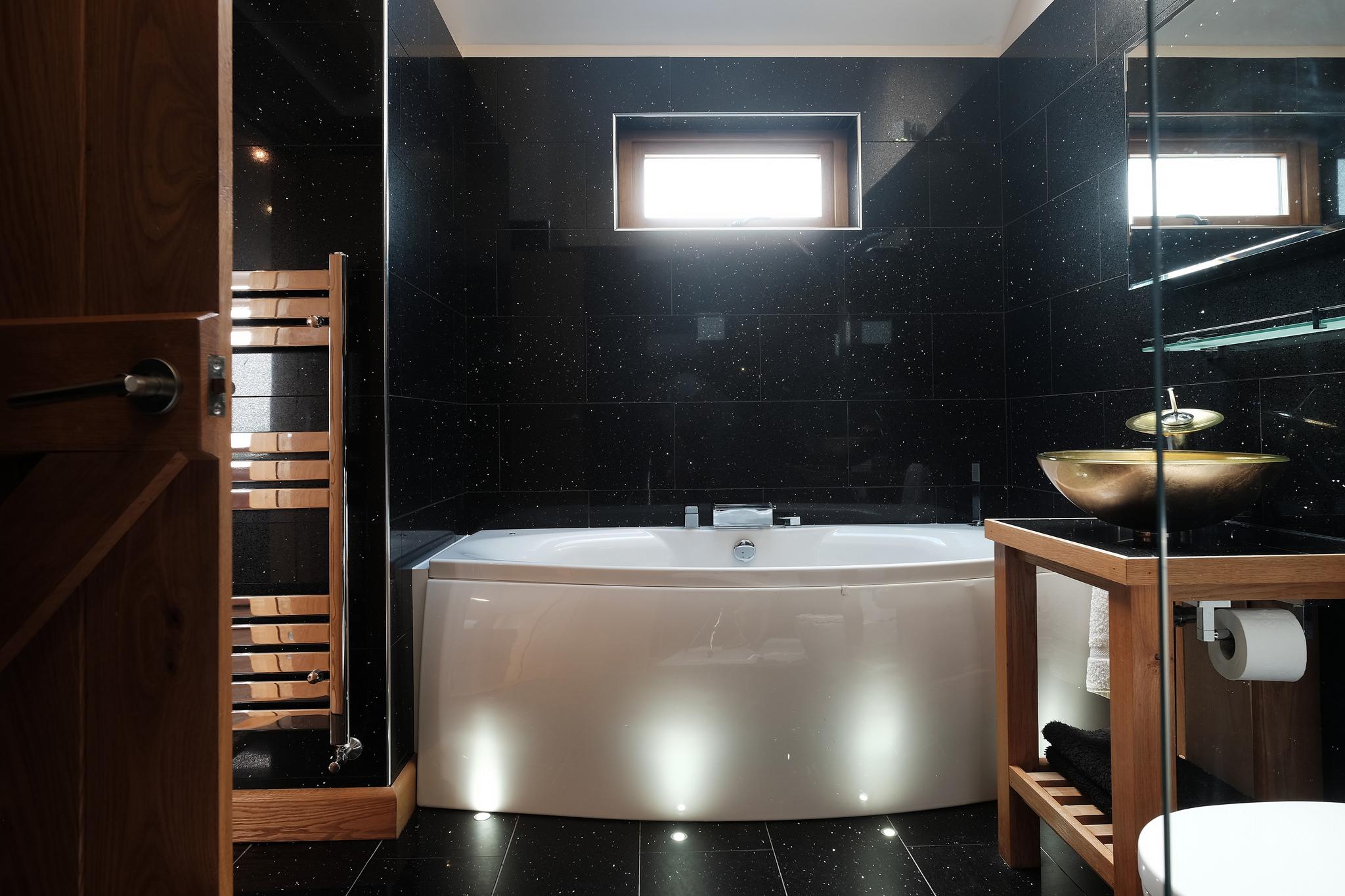 Spa bath with ground lighting