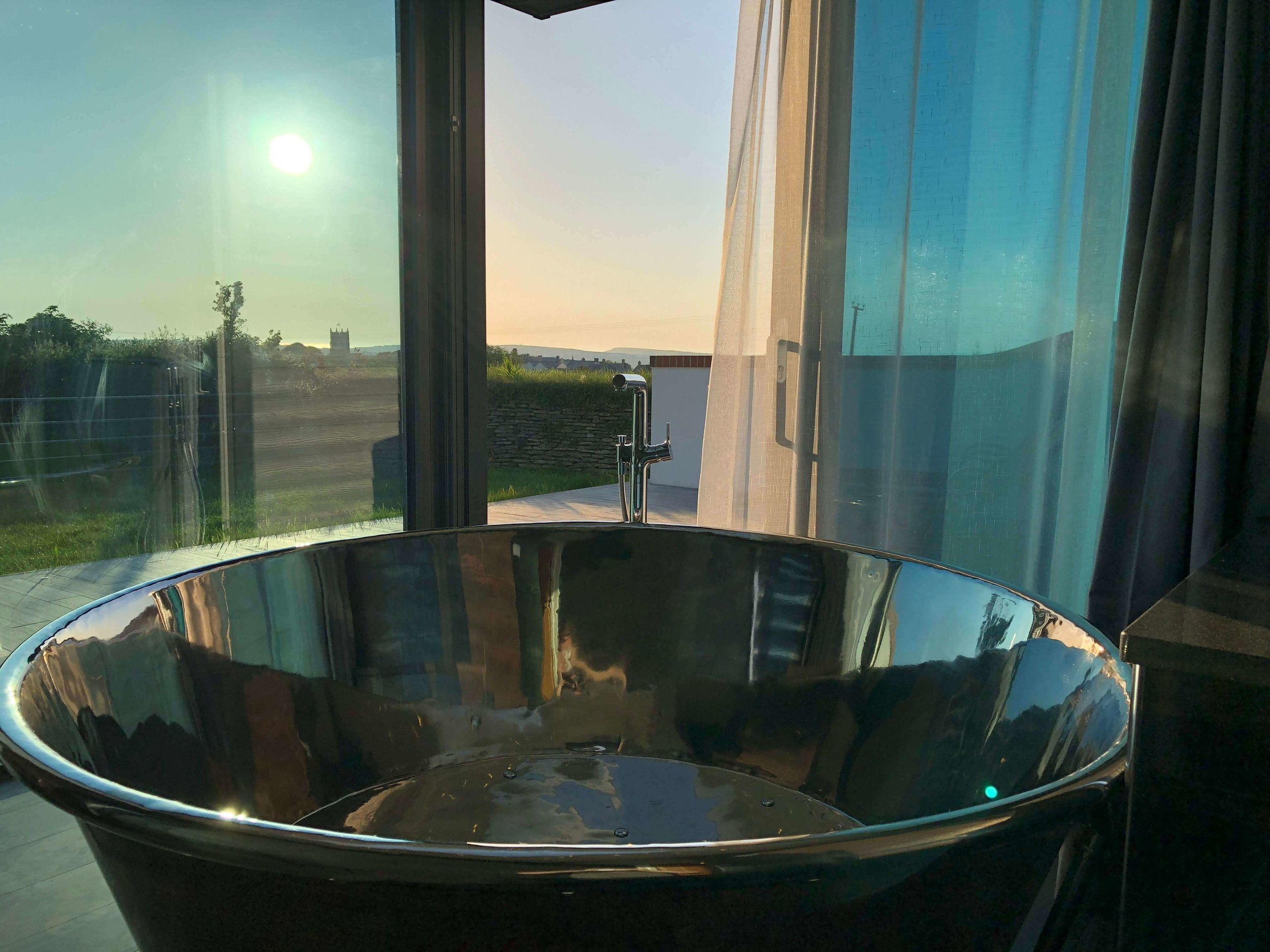 Sundancer round copper bath with air-spa system and sea views