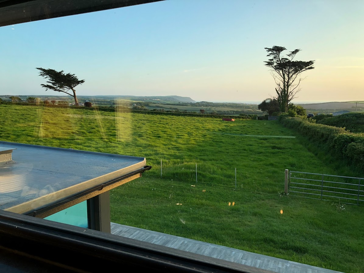 Sunset over Widemouth Bay from the bathroom window