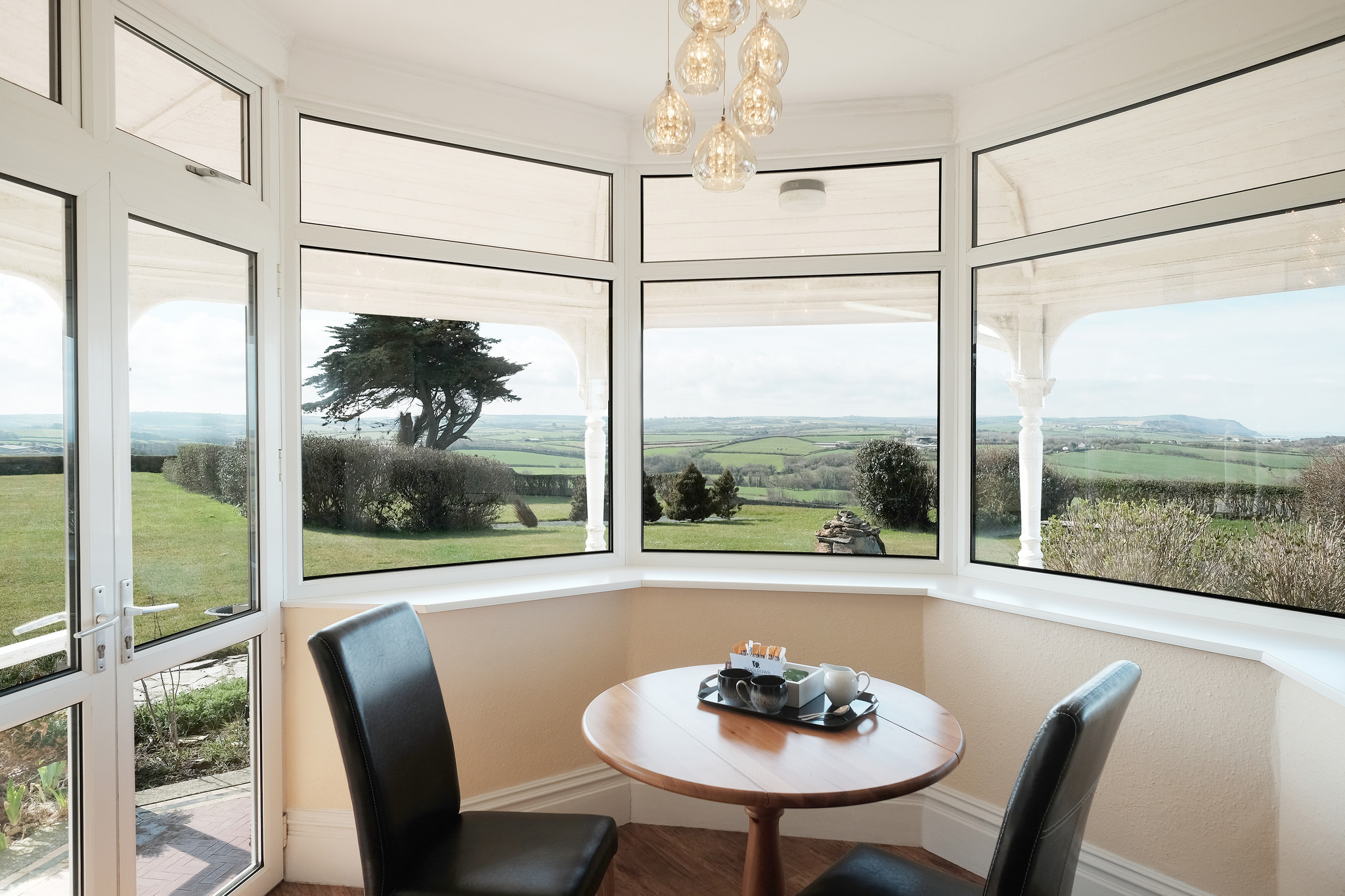 Dining area for two with views of the lawn and rolling countryside