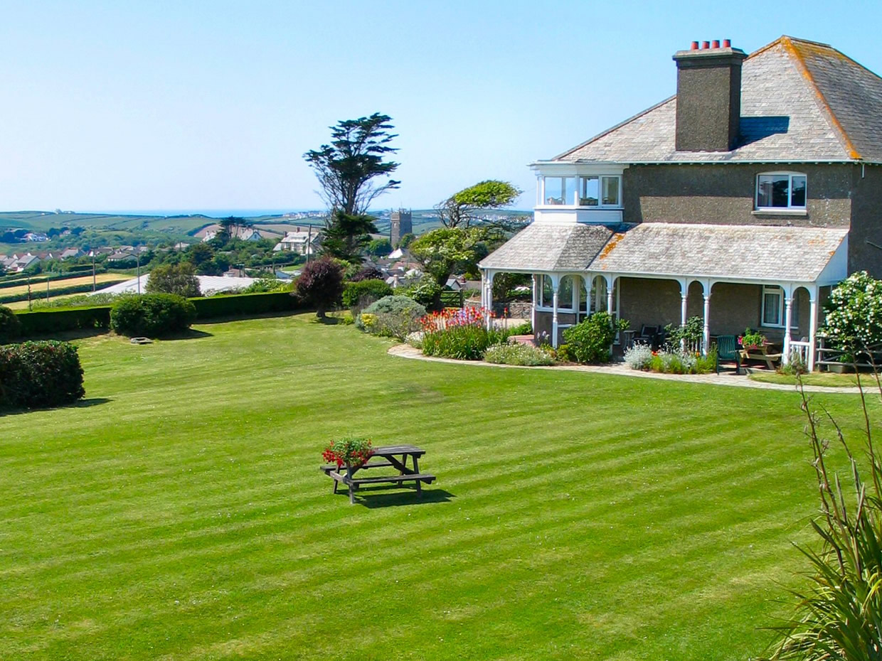 Lawn and veranda with sea and countryside views