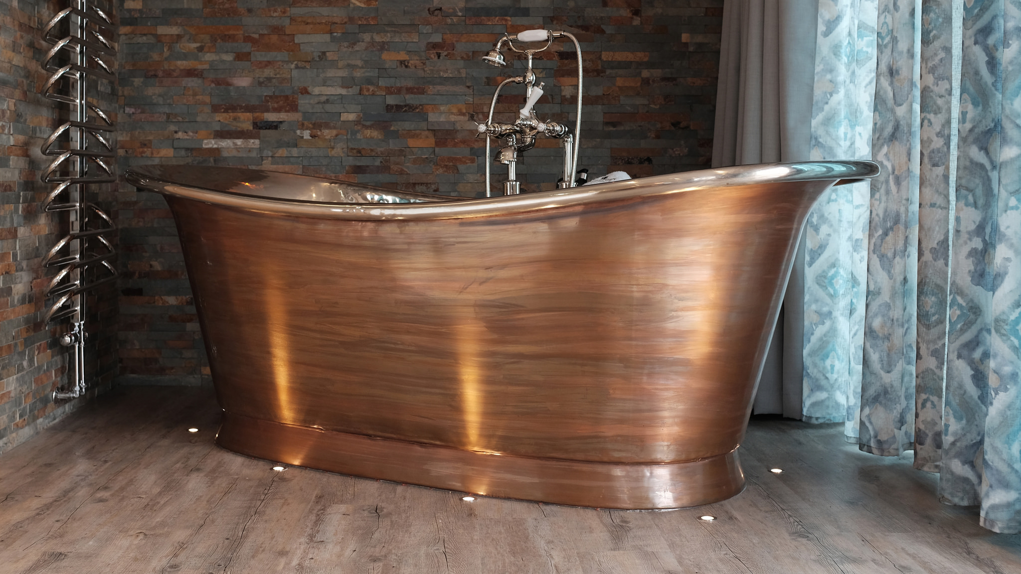 Brushed copper spa bath for two