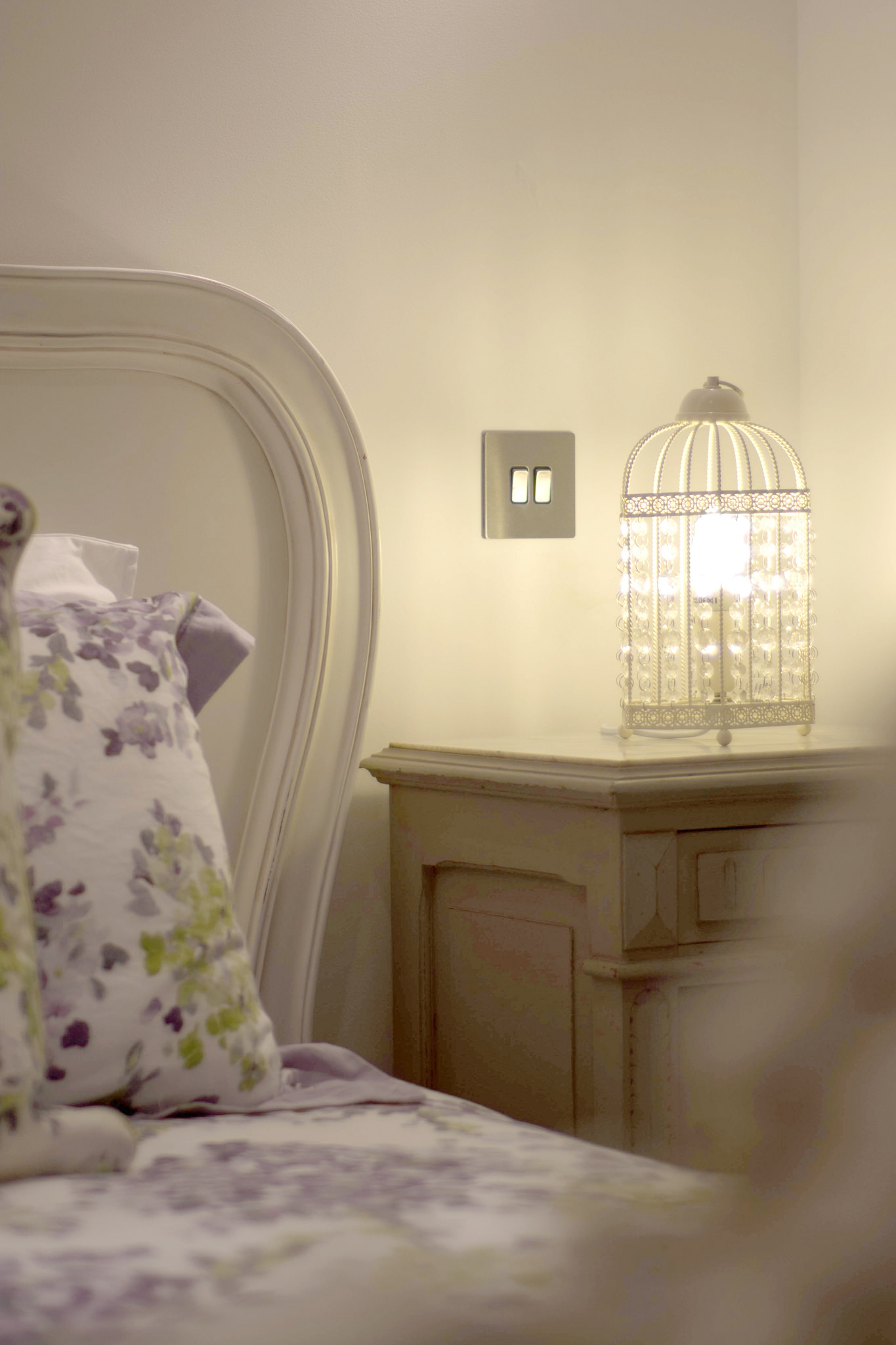 Romantic bedroom with original French bedside tables