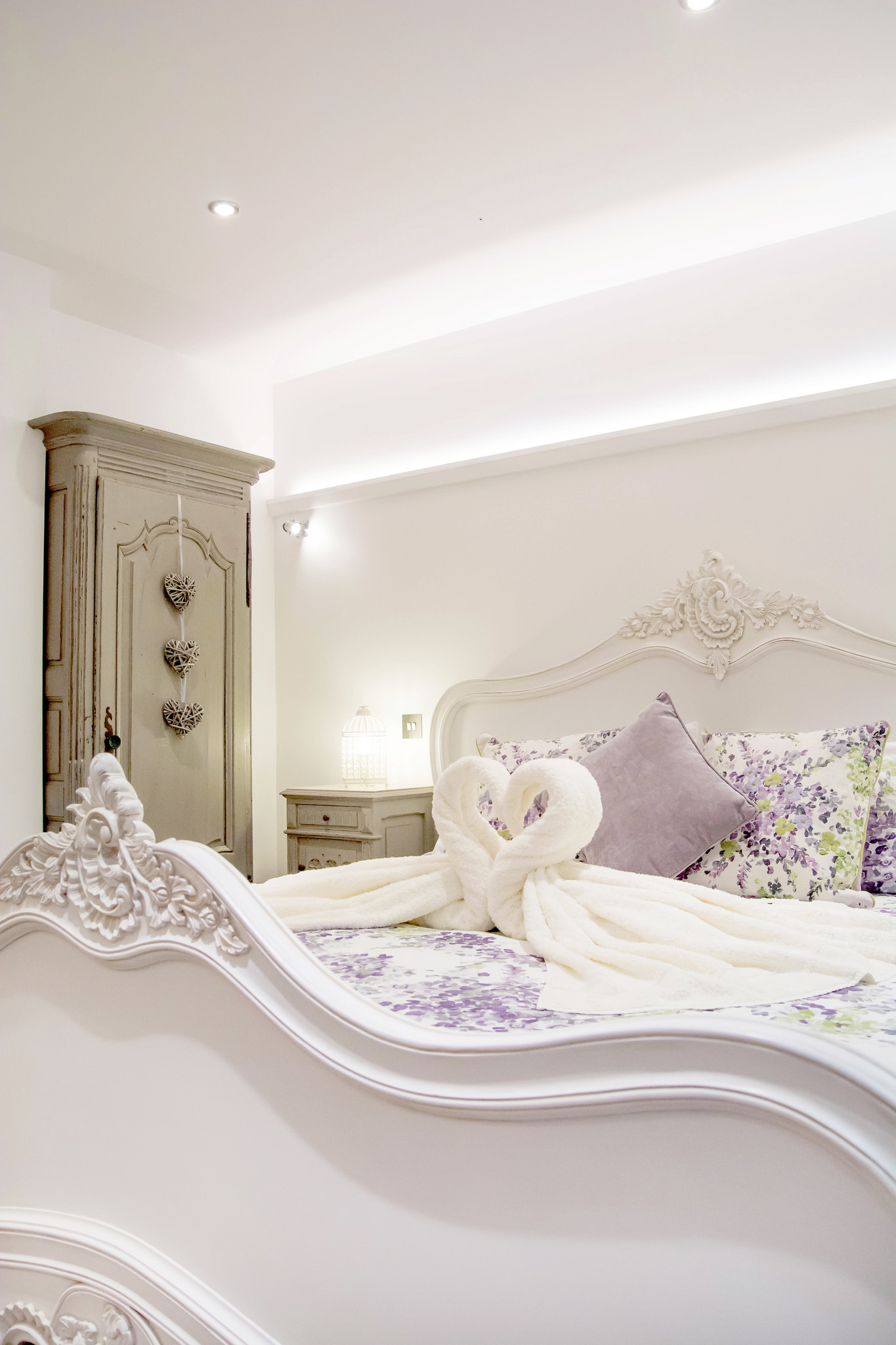 Carved French super-king size bed and ambient room lighting