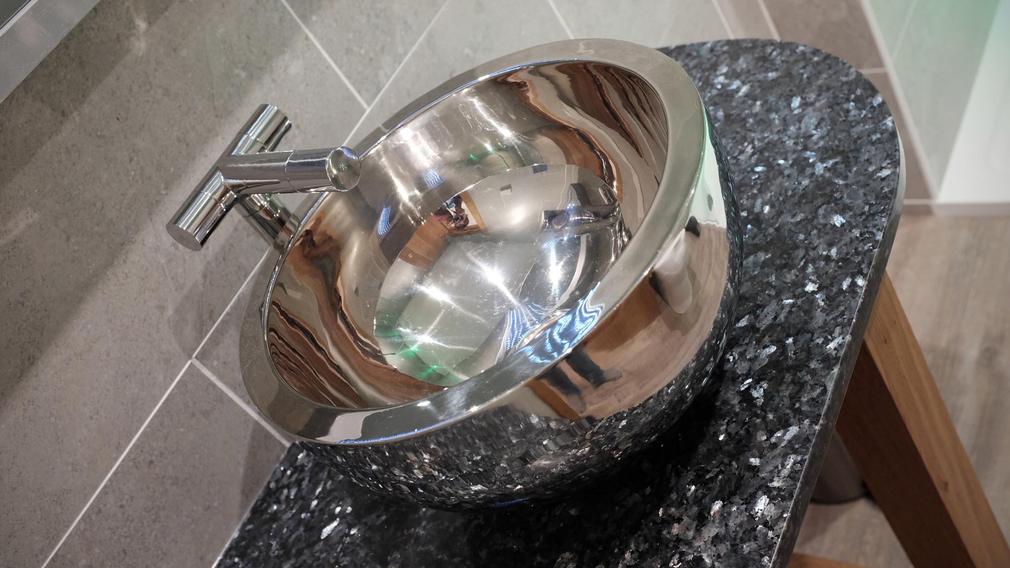 Bathroom hand basin with nickel interior