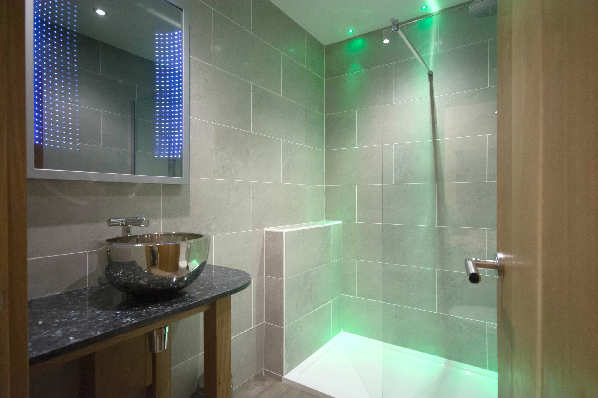 Bathroom with walk-in rainfall shower and LED mirror