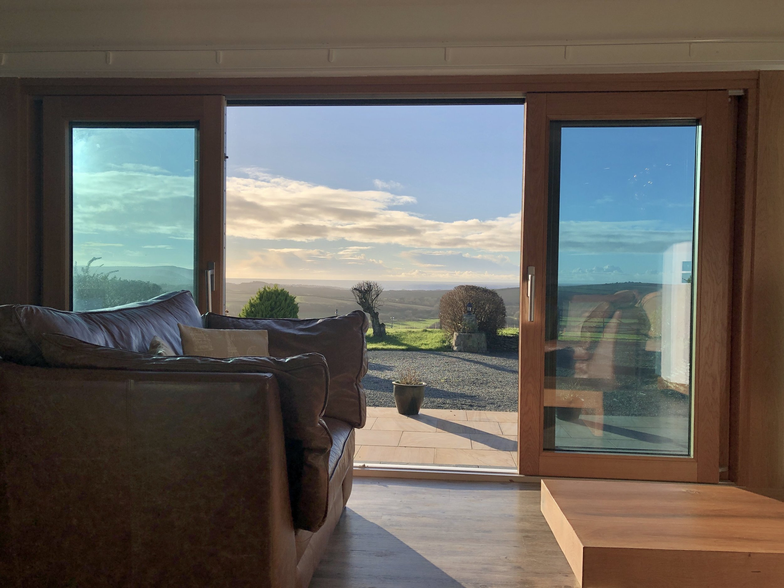 Living area with countryside and sea views towards Widemouth Bay, Bude