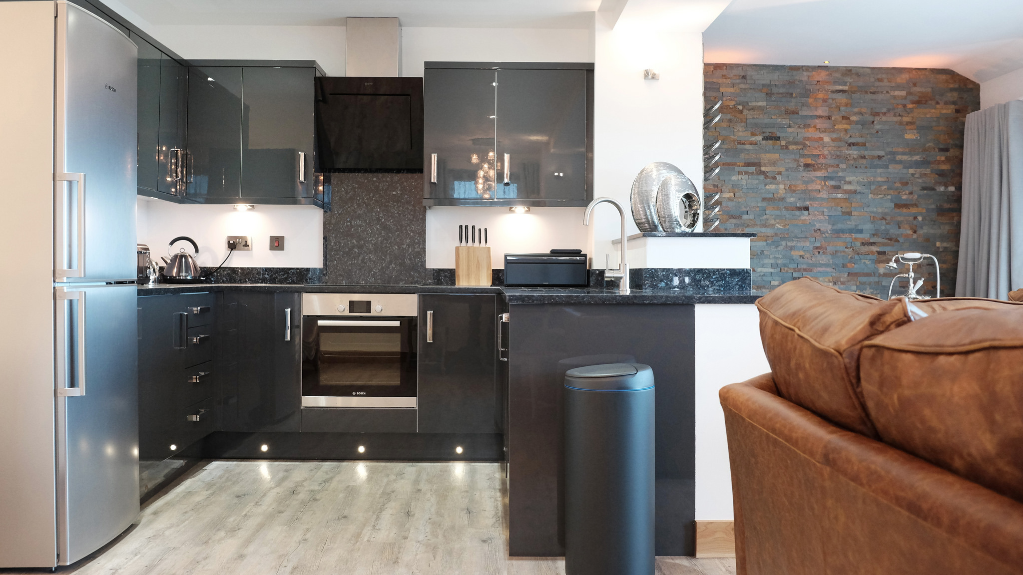 Open plan layout with grey kitchen and granite worktops