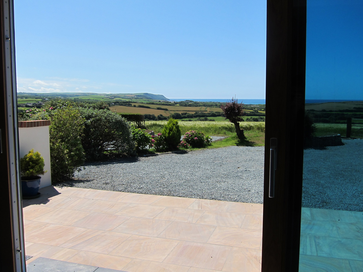 Patio area with views of the countryside and sea at Widemouth Bay