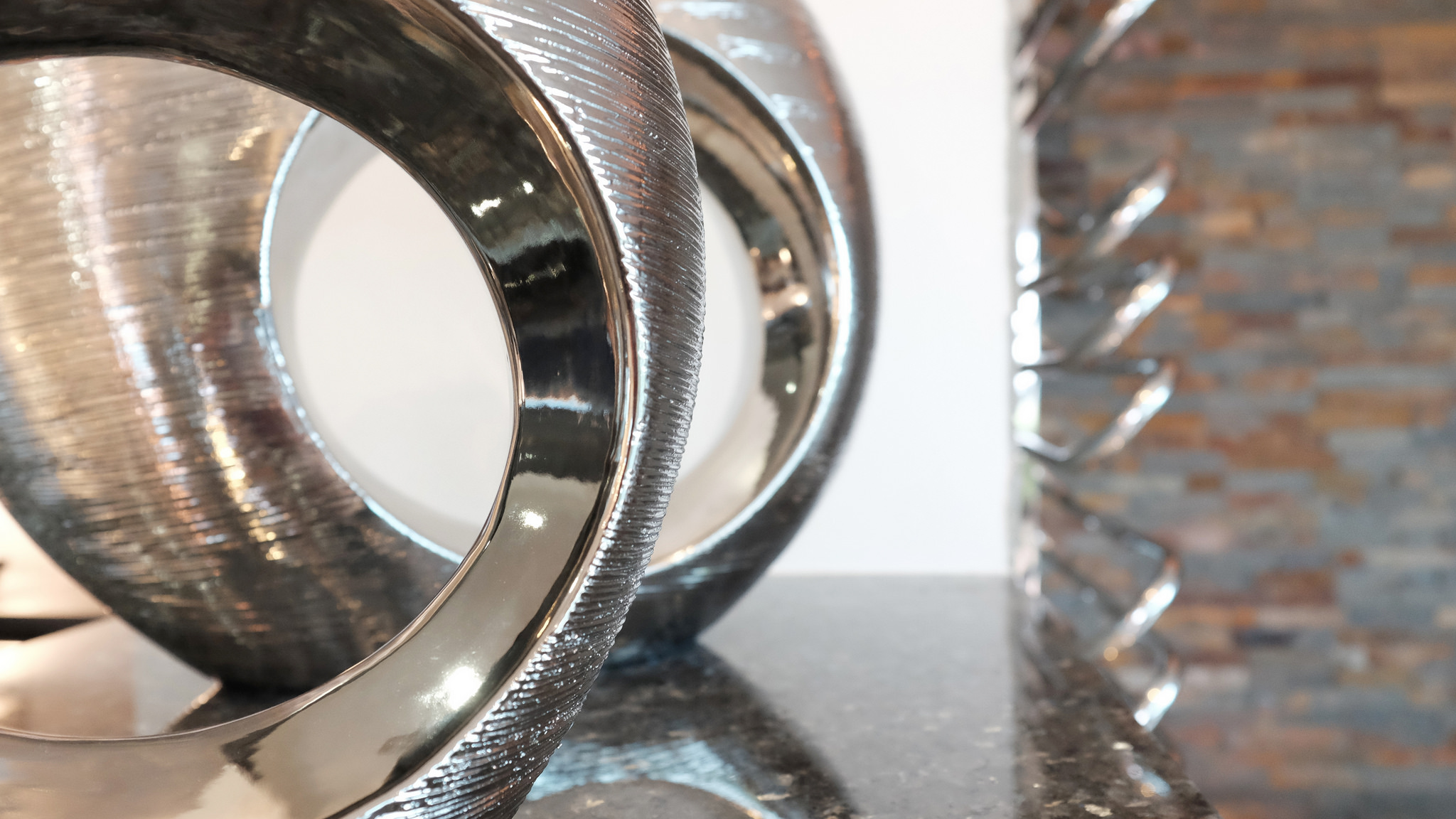 Silver ornaments and designer towel rail