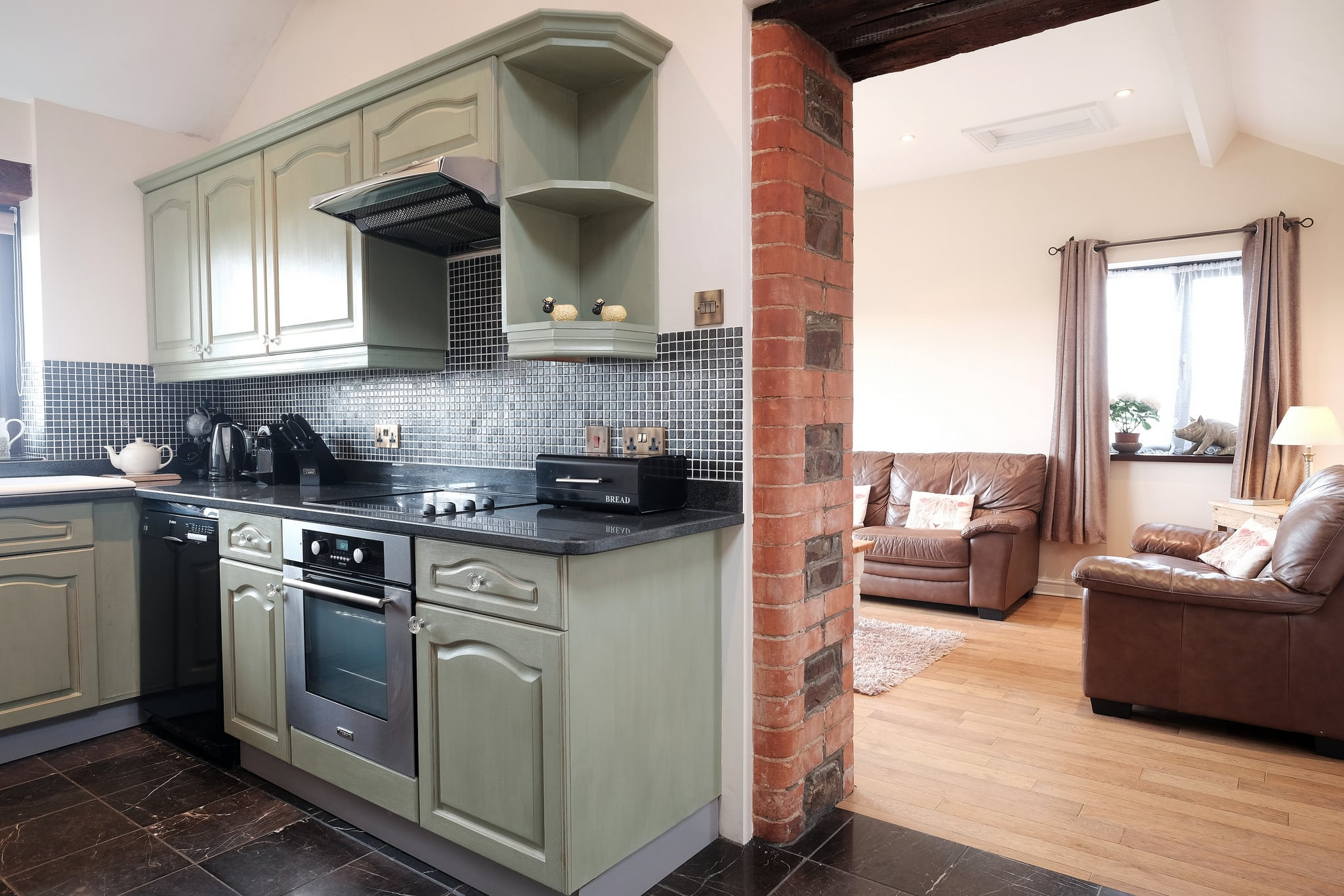 Shabby chic country style kitchen with granite worktops