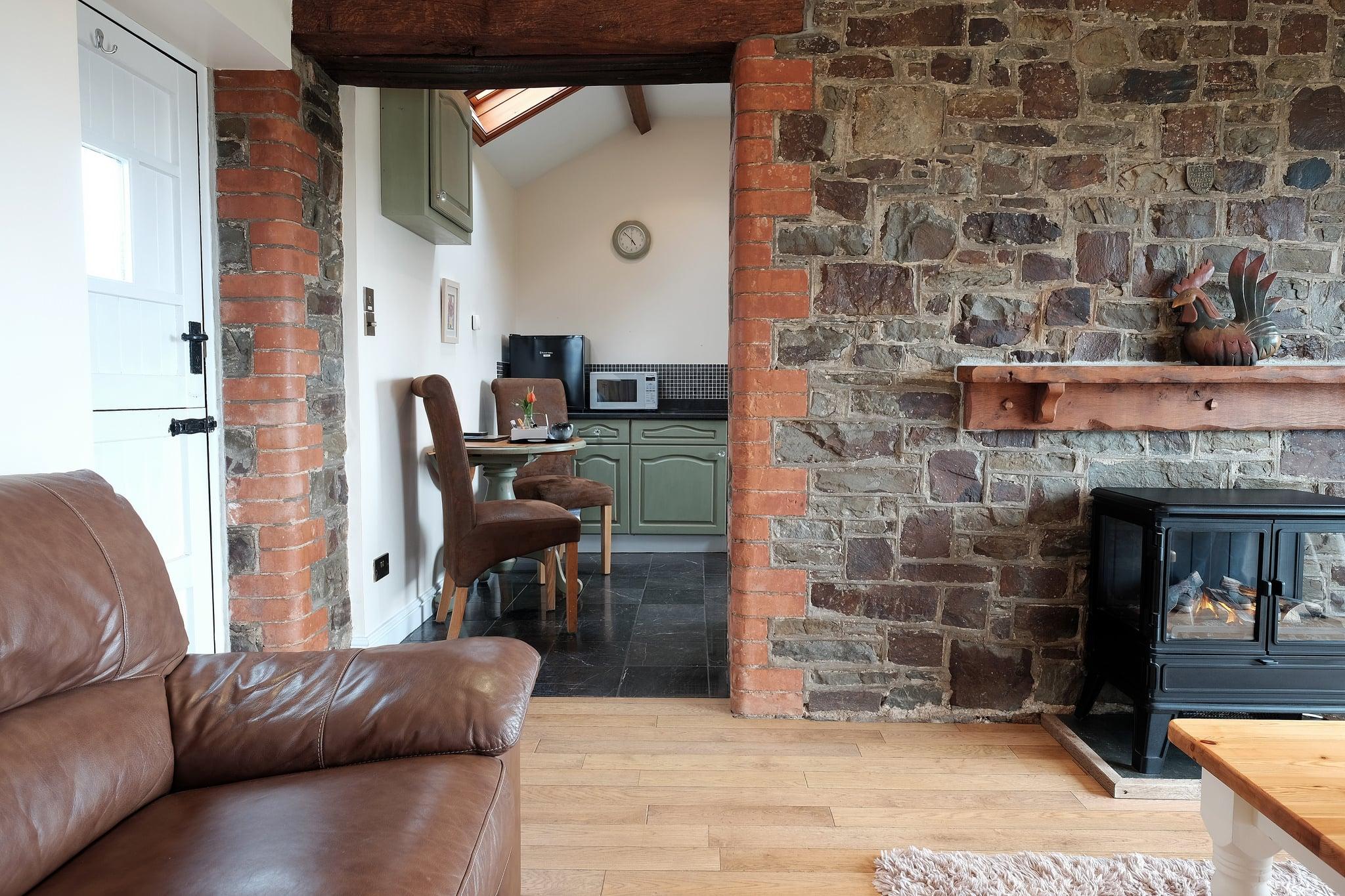 Barn conversion interior showing parts of the original stone wall