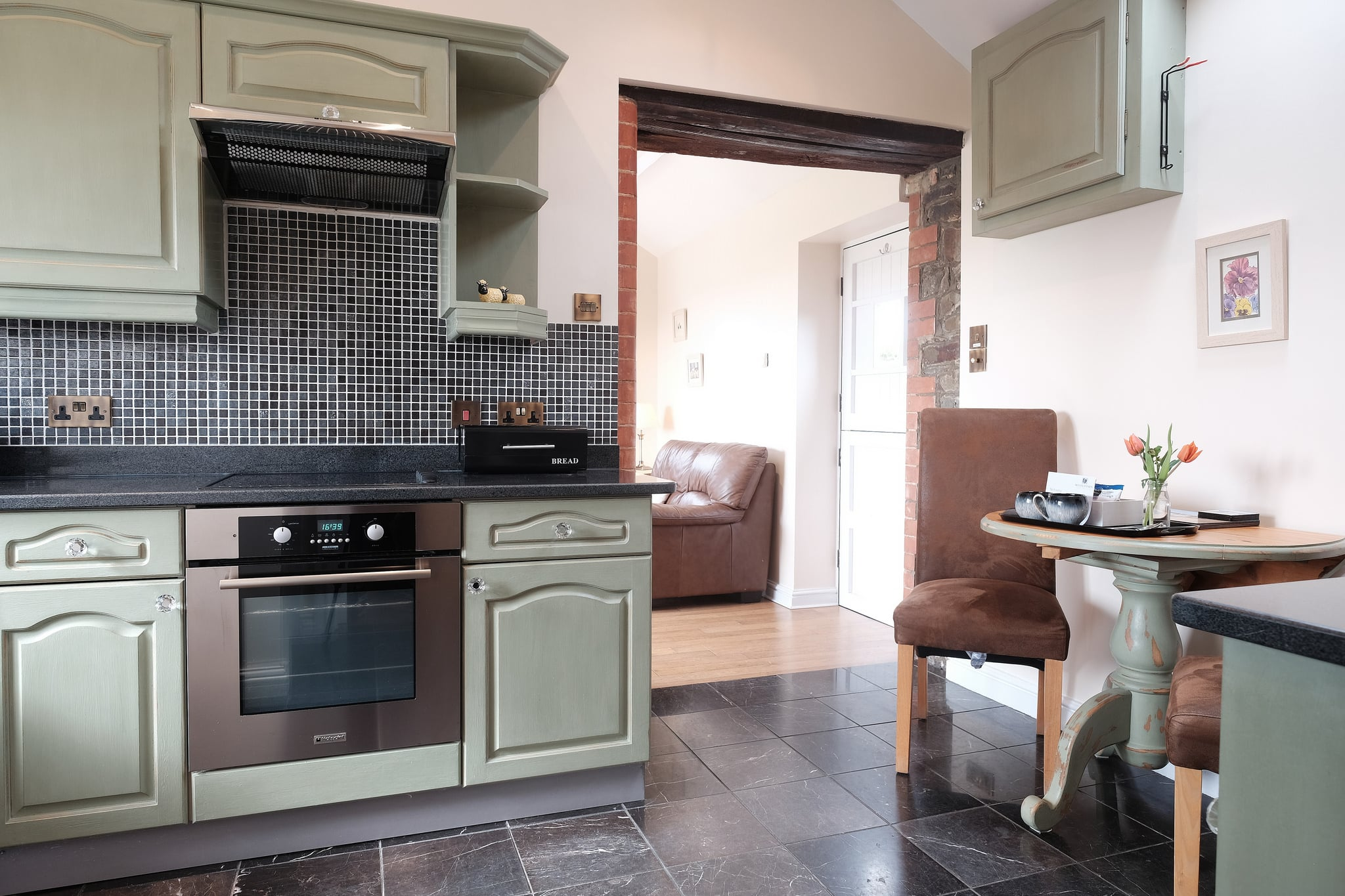 Shabby chic kitchen with dining area just for two