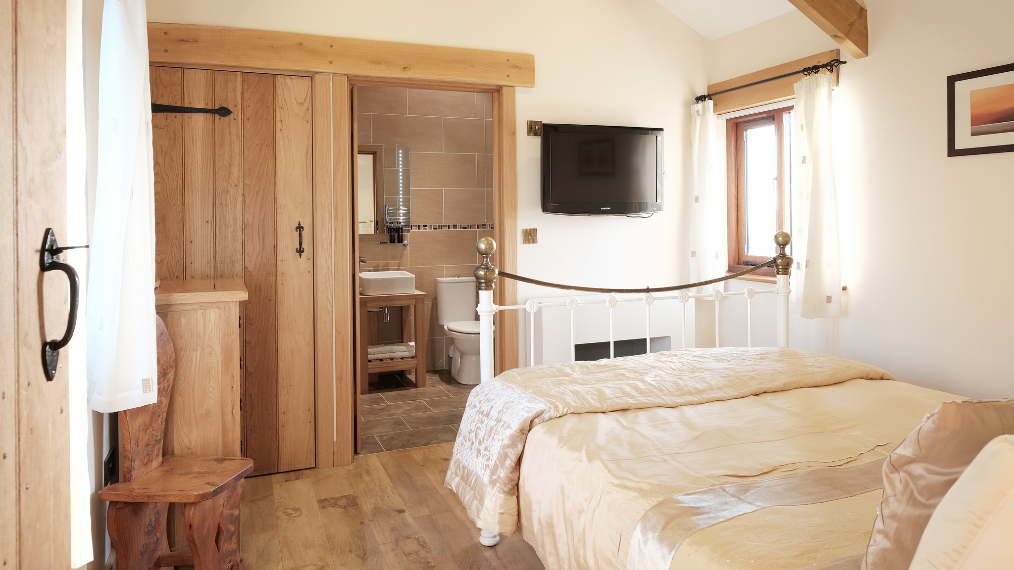Bedroom with king size bed and en-suite bathroom