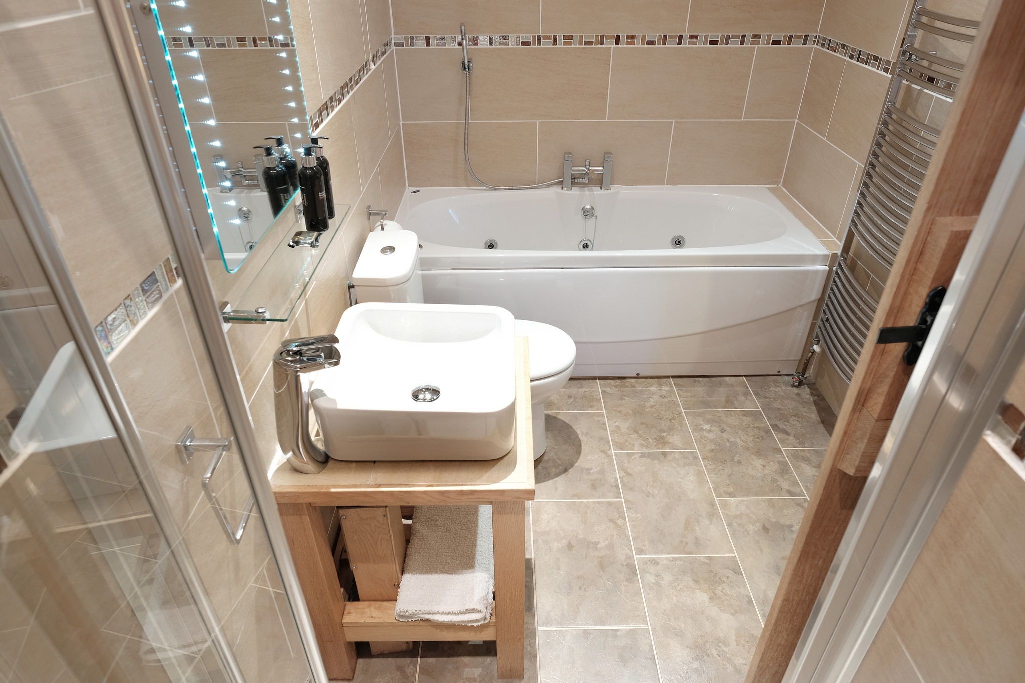 Ensuite bathroom with spa bath and walk in shower