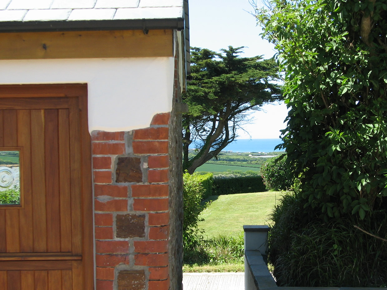Countryside view from the entrance door looking towards the sea at Widemouth Bay