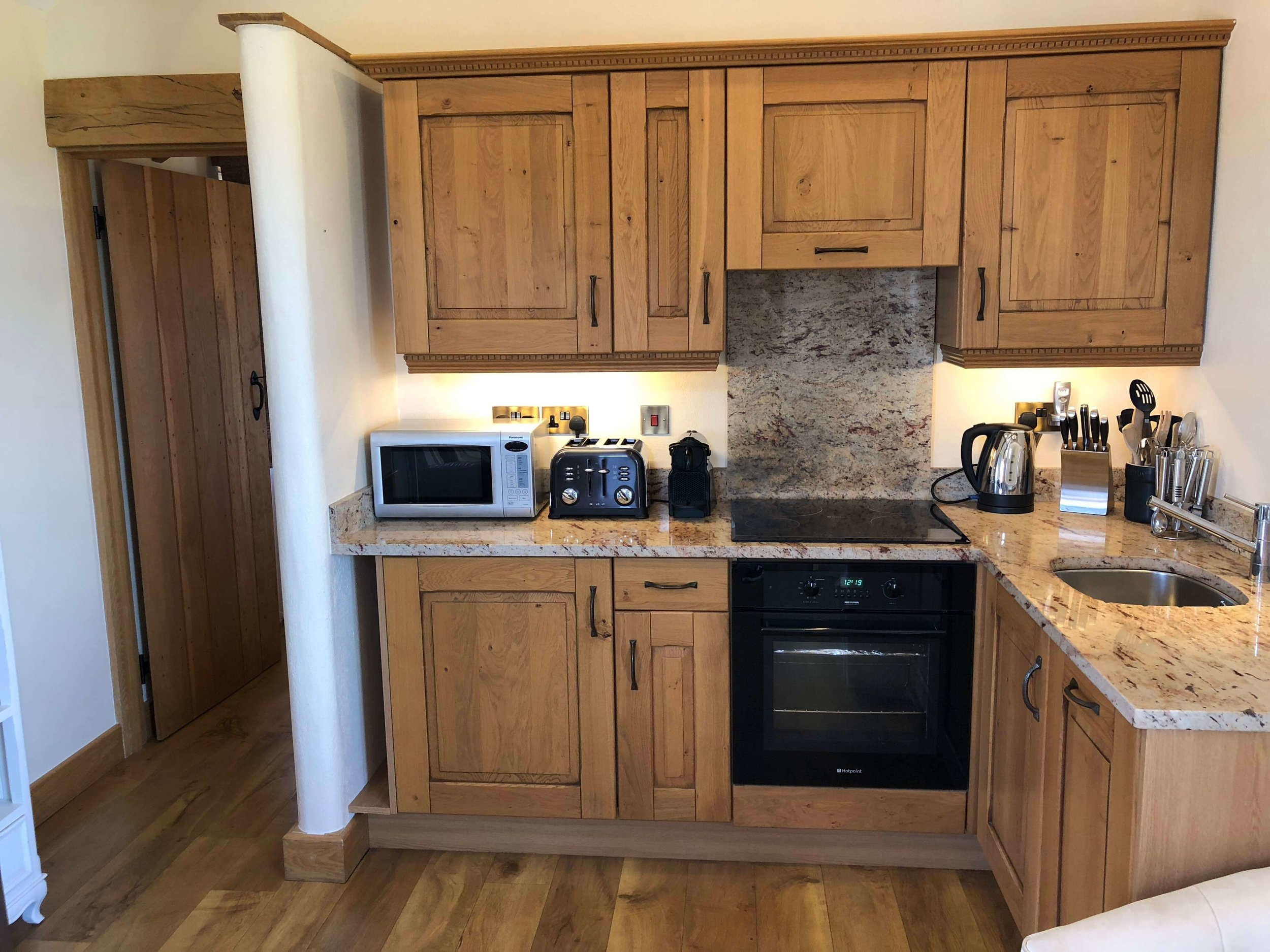 Compact fully equipped kitchen with granite worktops