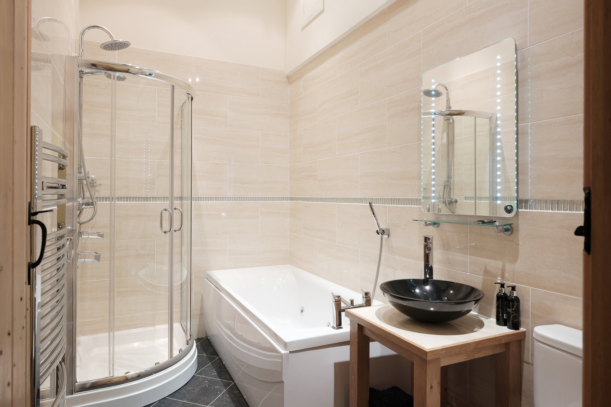 Bathroom with spa bath and walk in shower