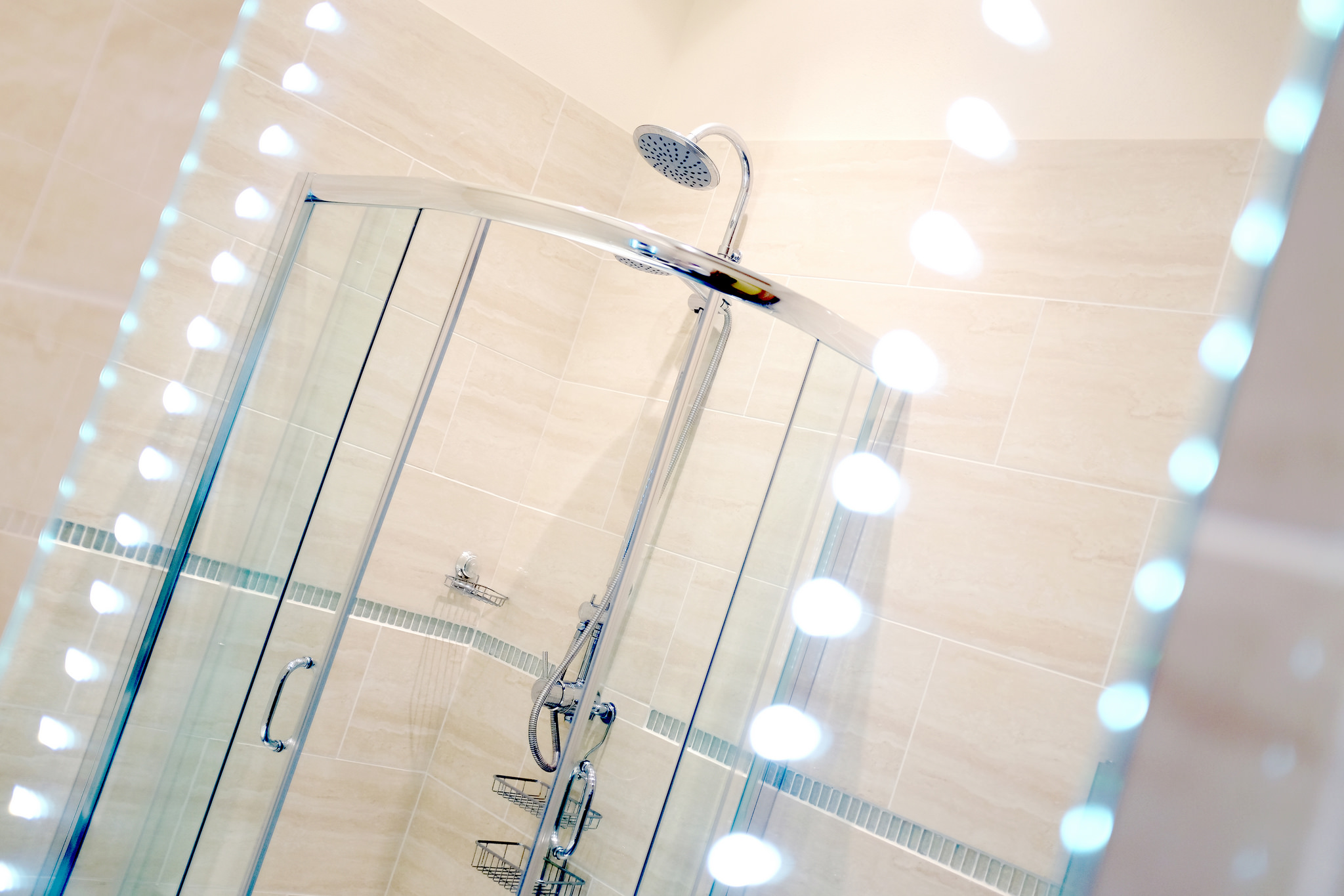 LED mirror with the walk-shower showing in reflection