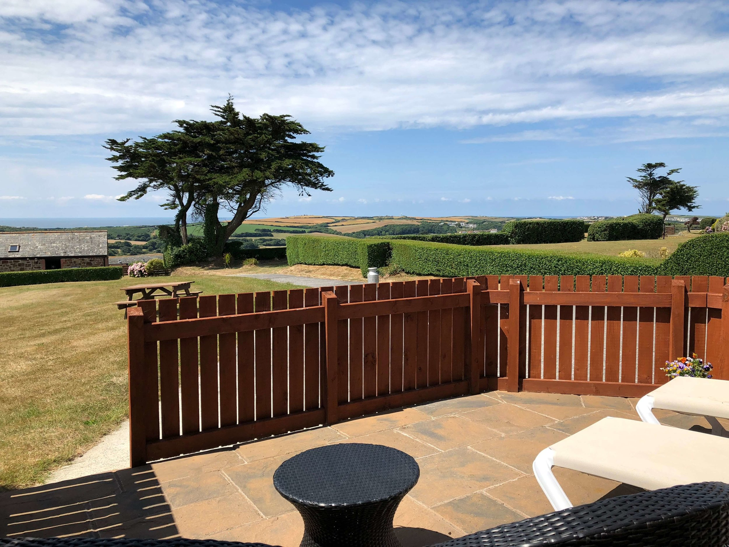 Patio area with countryside and sea views towards Widemouth Bay, Bude