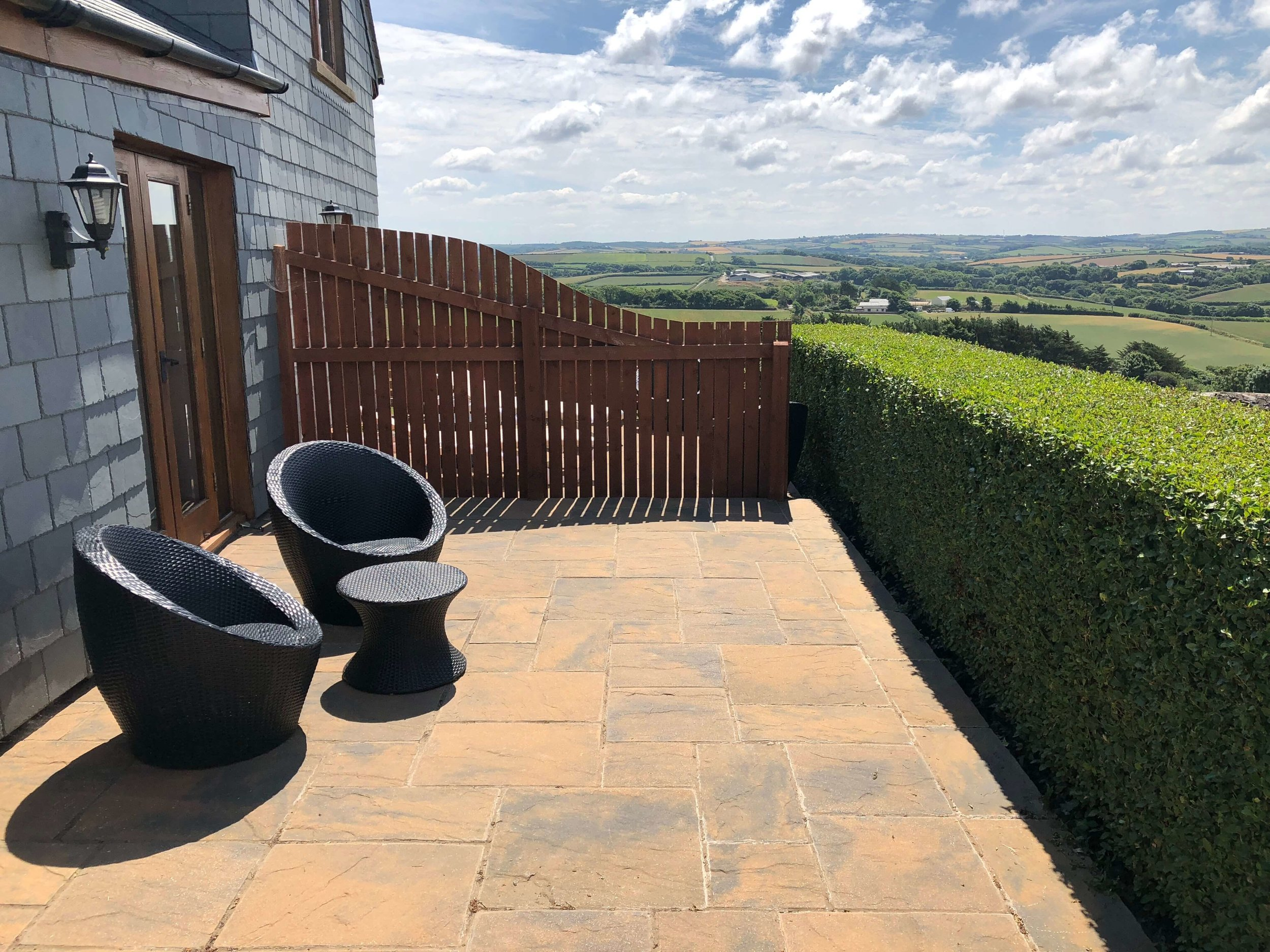 Spectacular sea and countryside views towards Widemouth Bay from the patio area