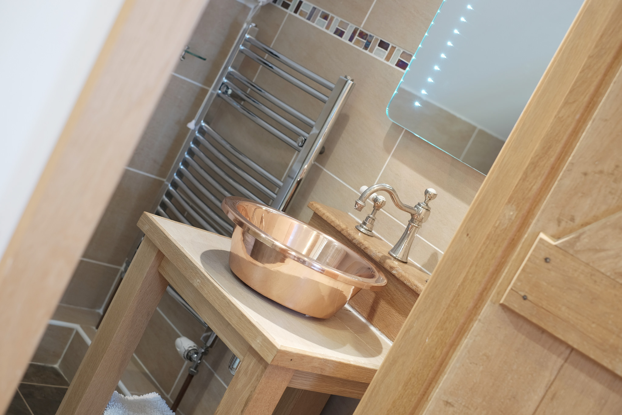 En-suite bathroom with luxury copper basin