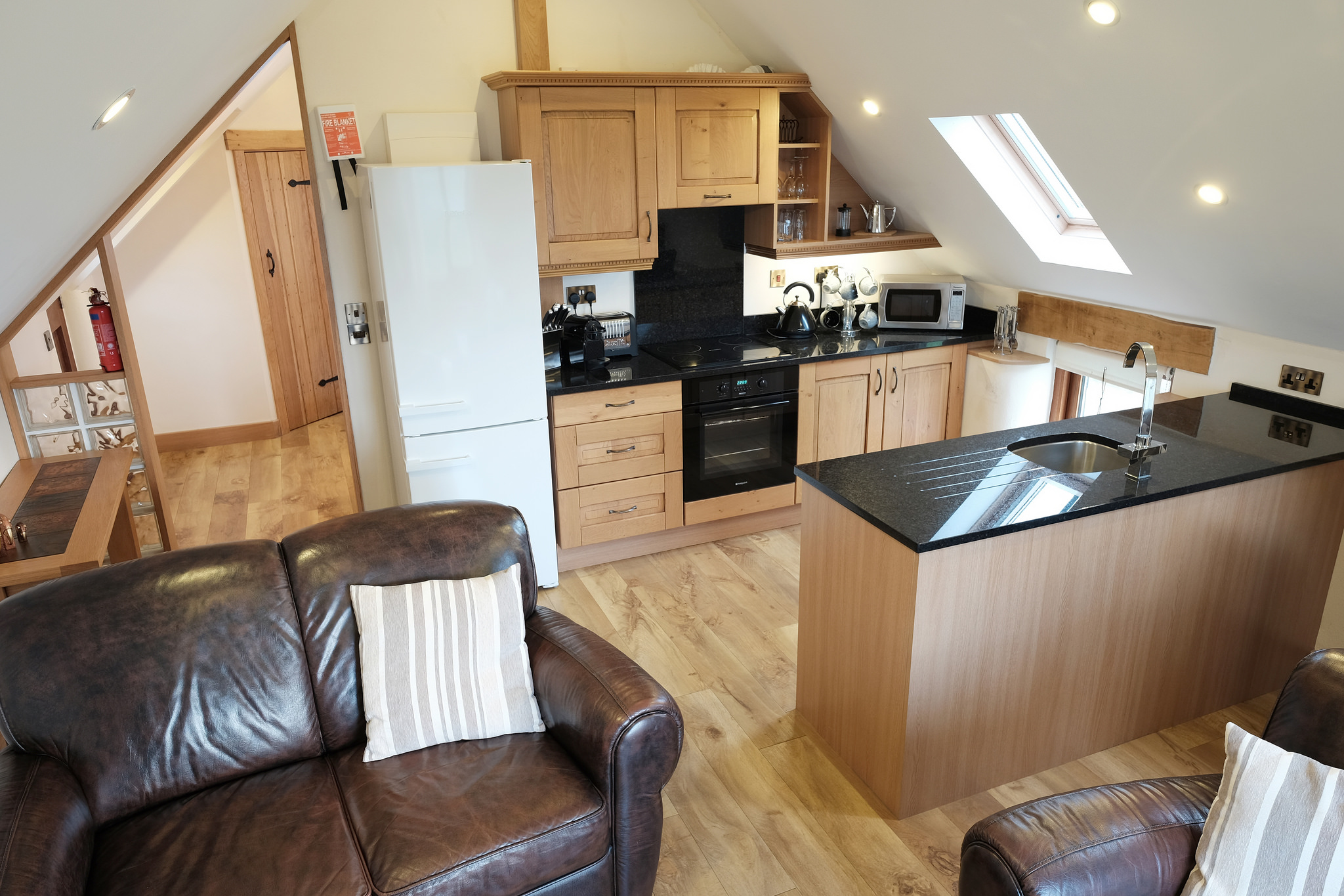 Open plan, fully equipped kitchen