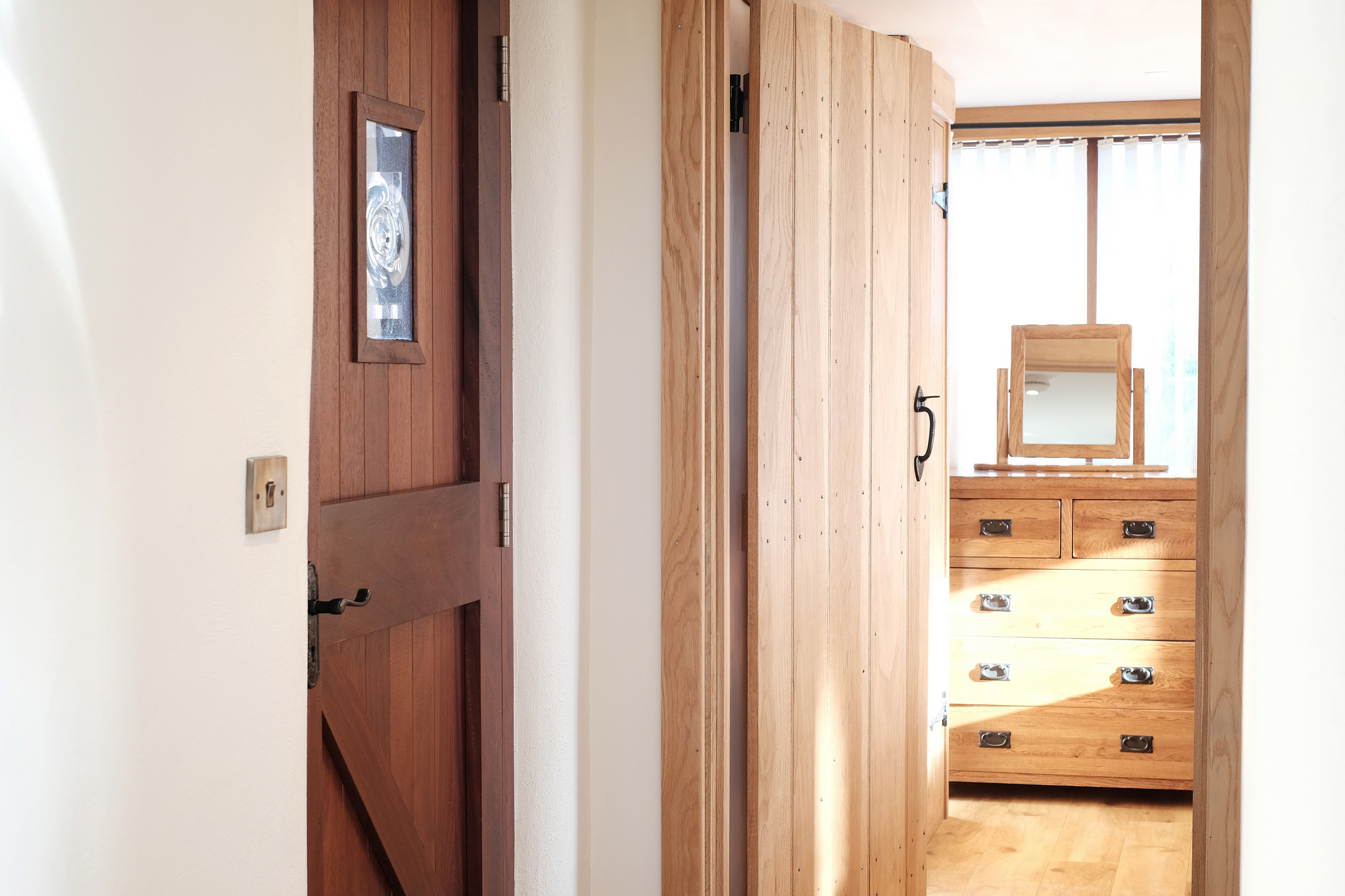 The entrance door looking towards the bedroom through the handmade oak door