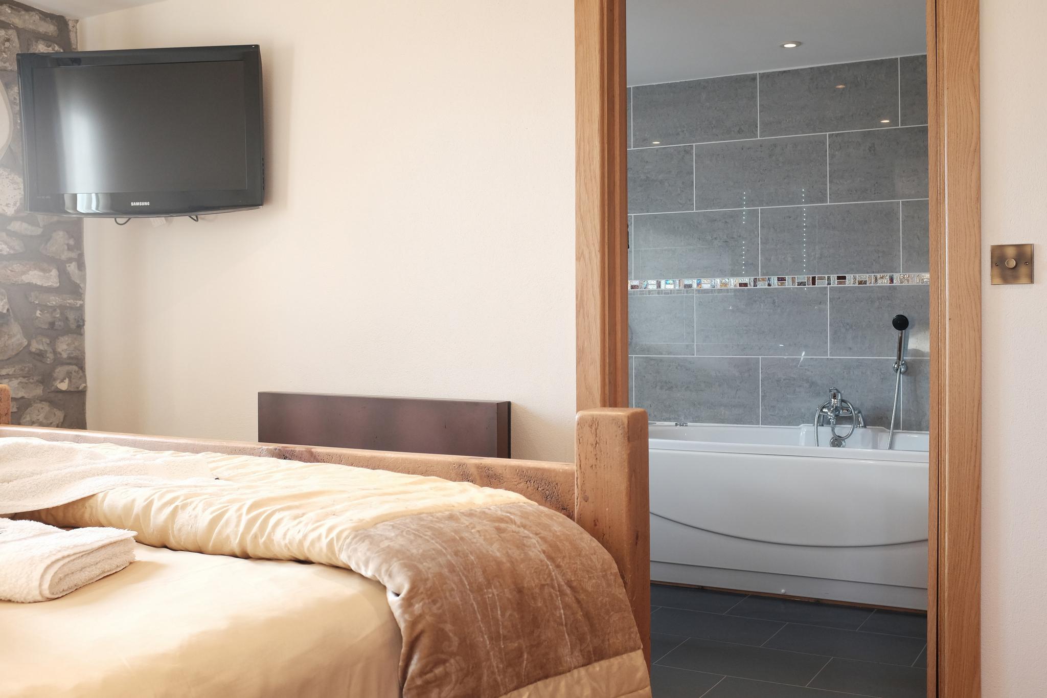 En-suite bathroom with spa bath and walk in shower