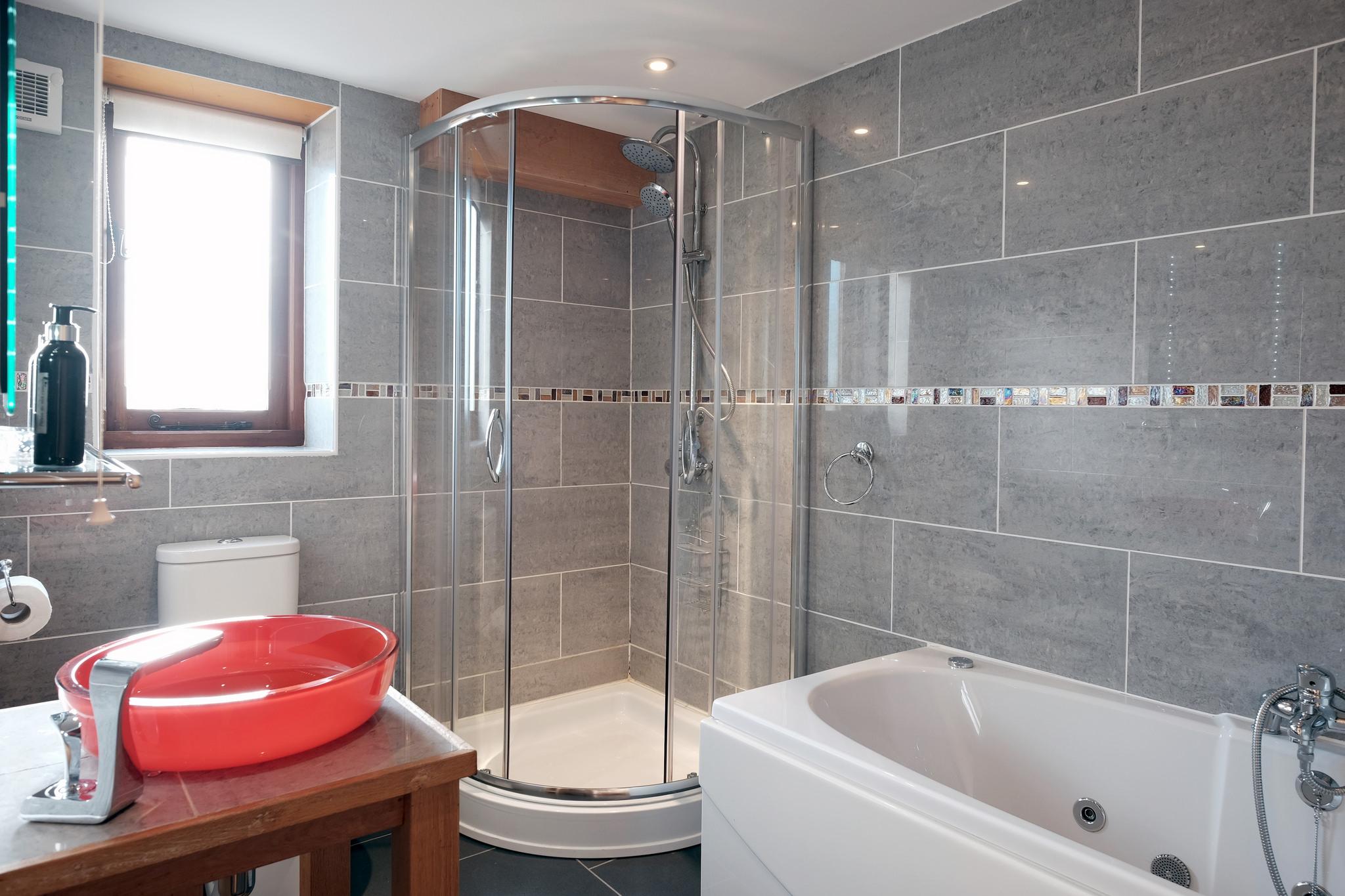 En-suite bathroom with spa bath and walk-in shower