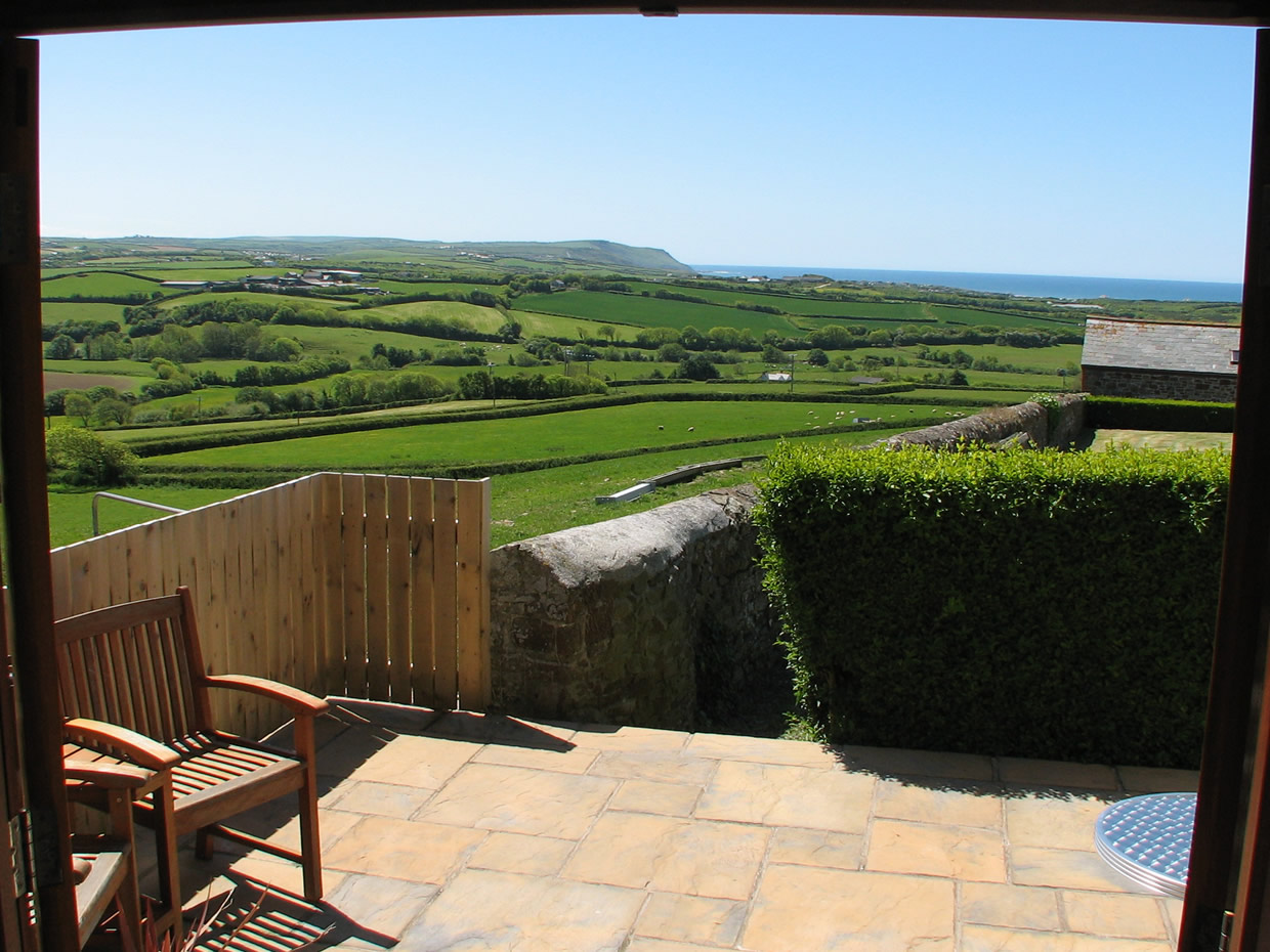 Countryside and sea views towards Widemouth Bay can be enjoyed inside and out