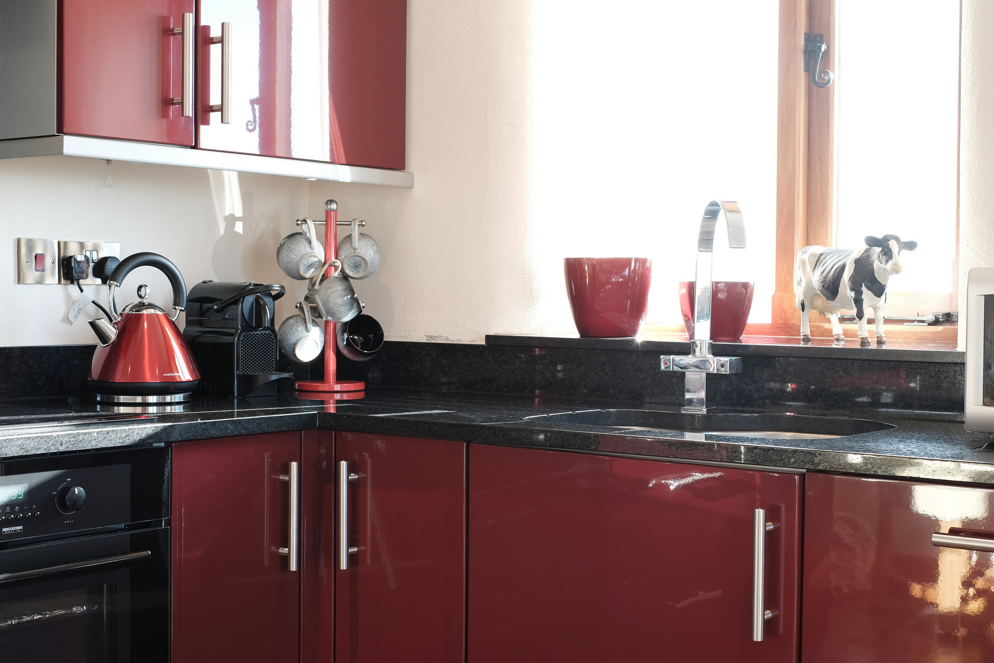 Modern red gloss kitchen with granite worktops