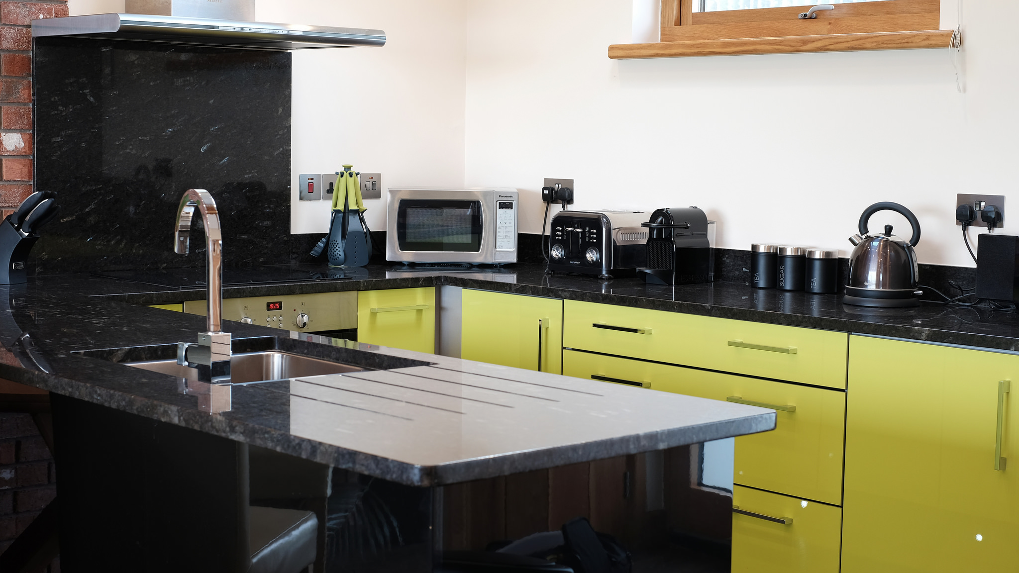 Lime green kitchen with granite worktops