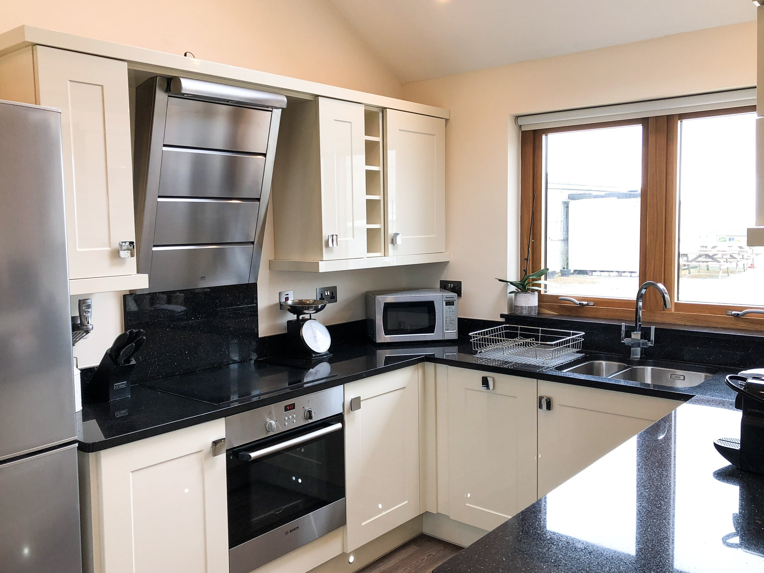 Cream kitchen with granite worktops
