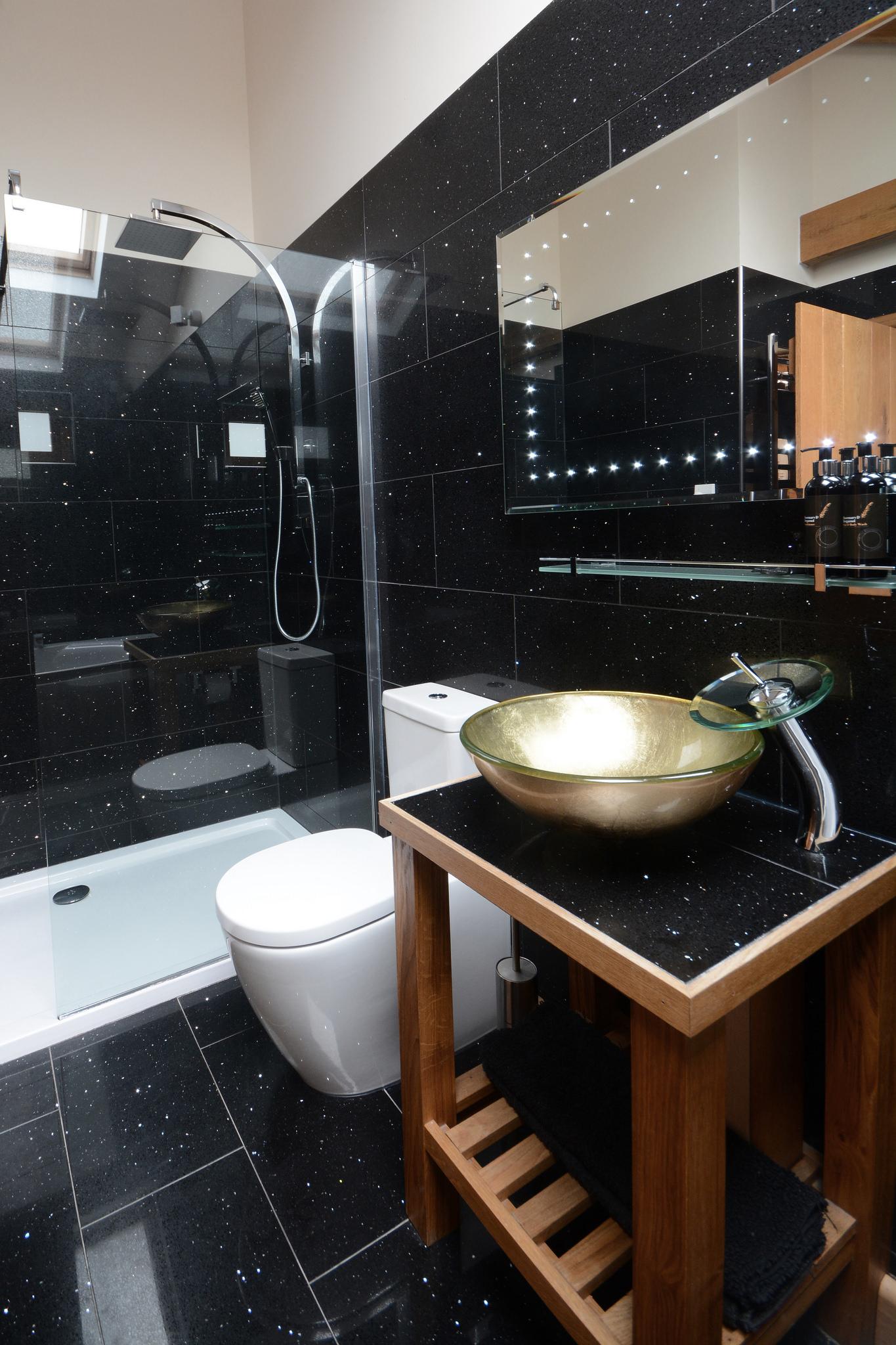 En-suite bathroom with walk-in rainfall shower