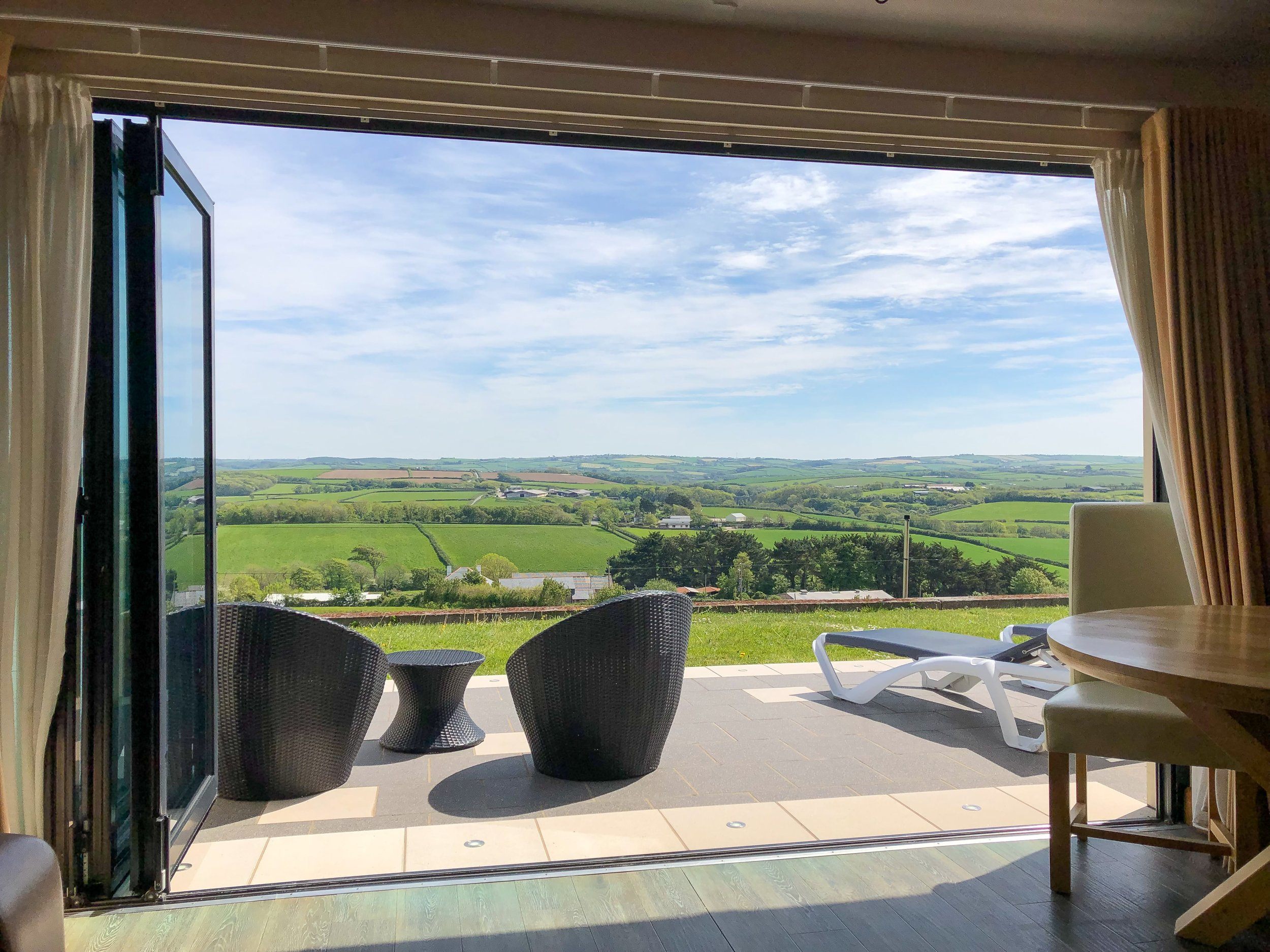 Bi-folding doors opening to the patio area with outstanding Cornish countryside views