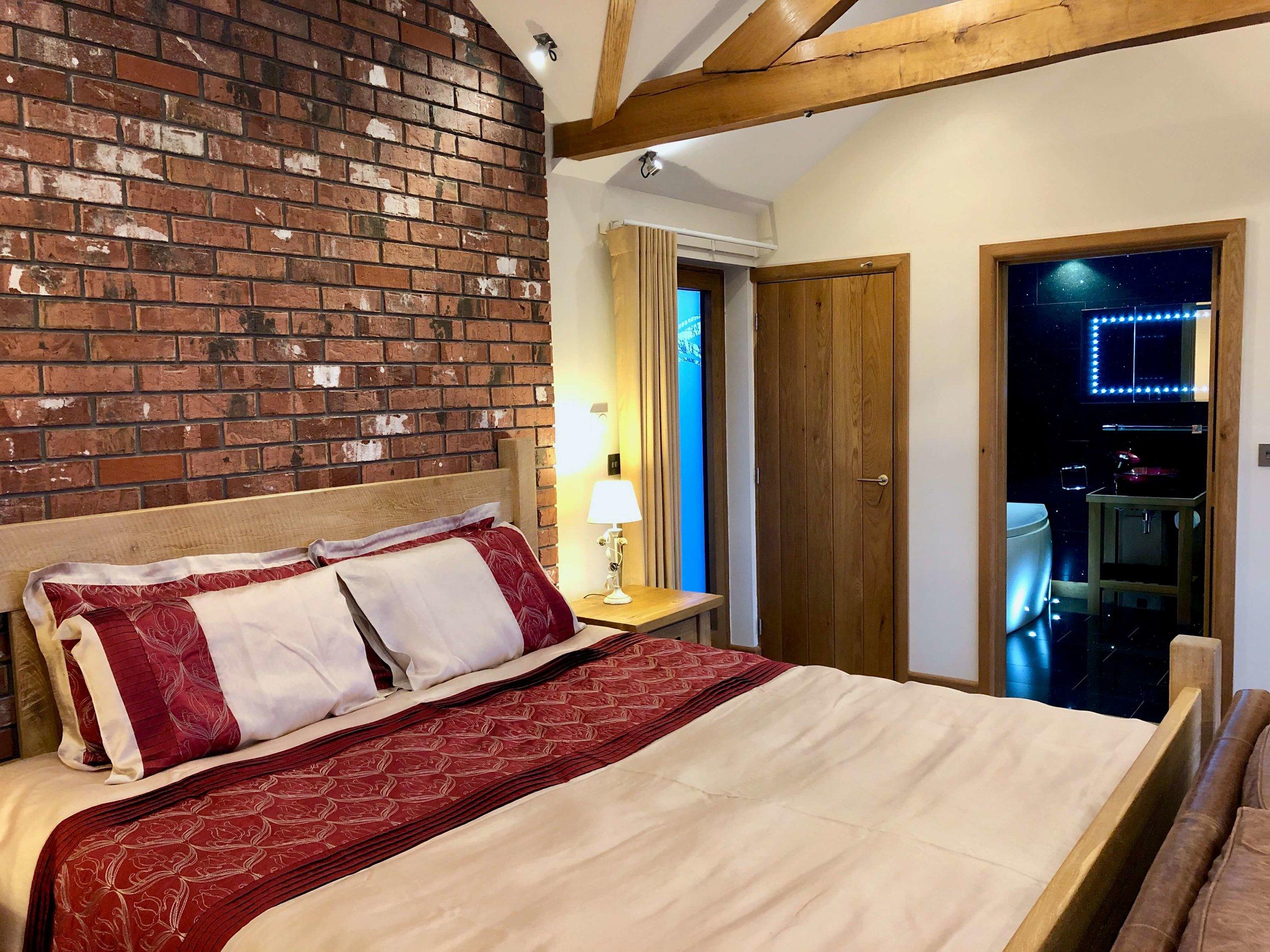 Super-king plank bed with en-suite bathroom