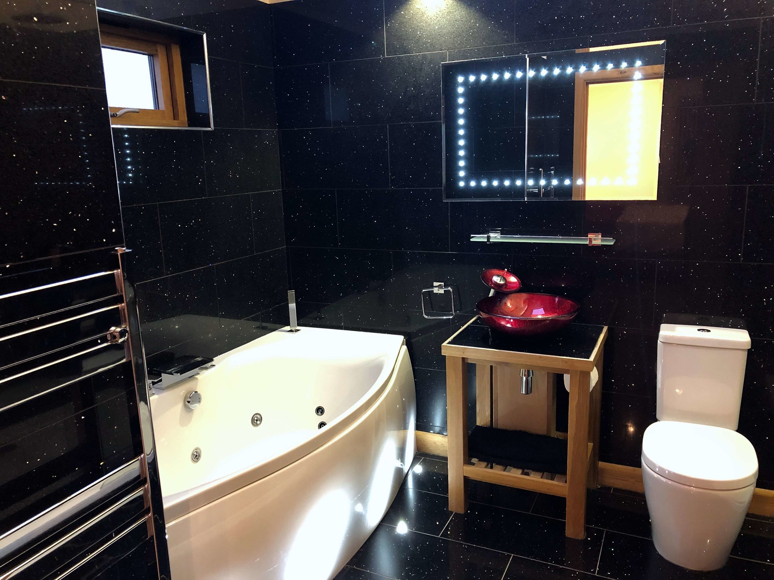 Bathroom with spa bath, floor lighting and LED mirror