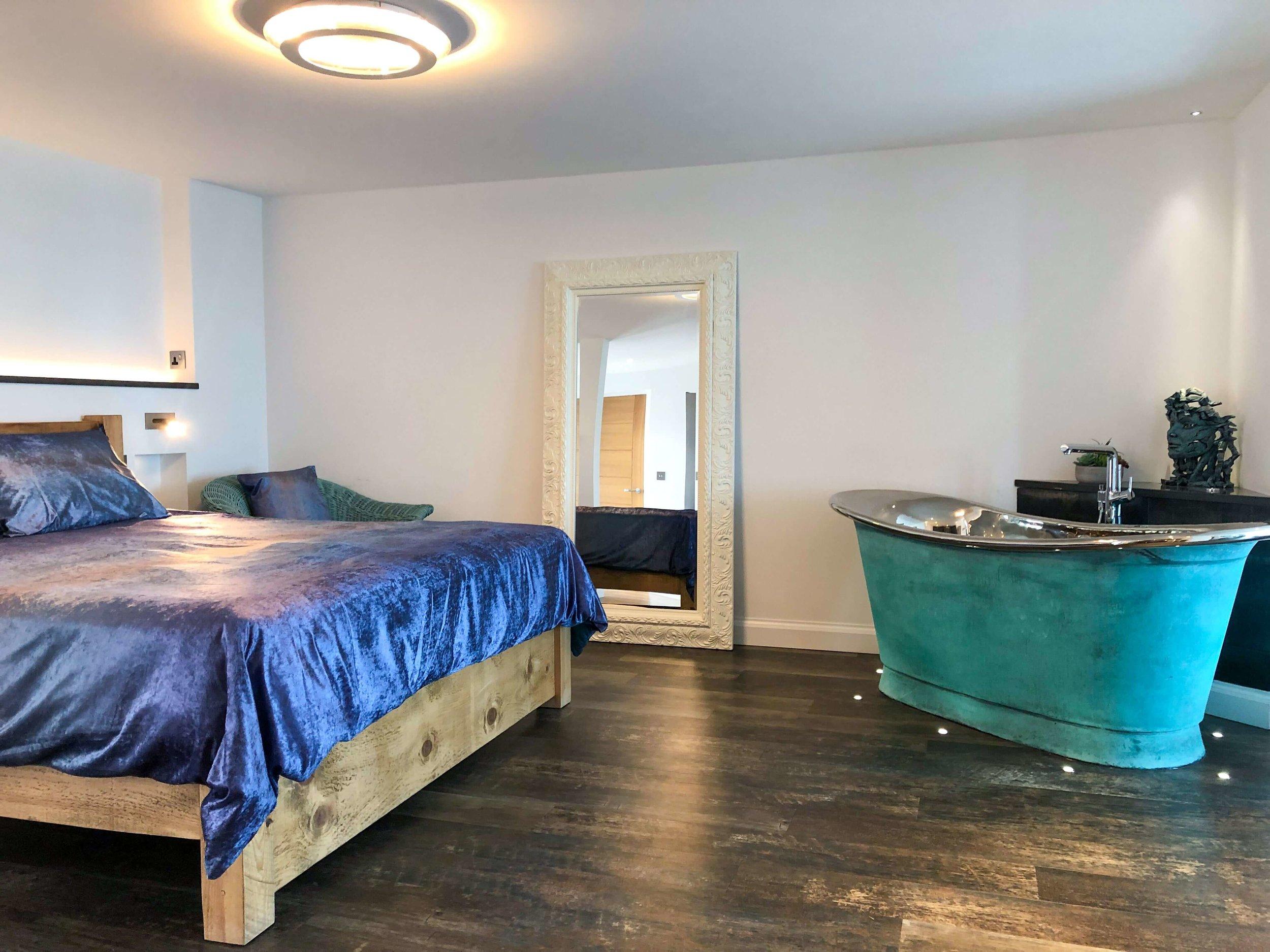 Silver Sea super-king size bedroom area and copper bath tub