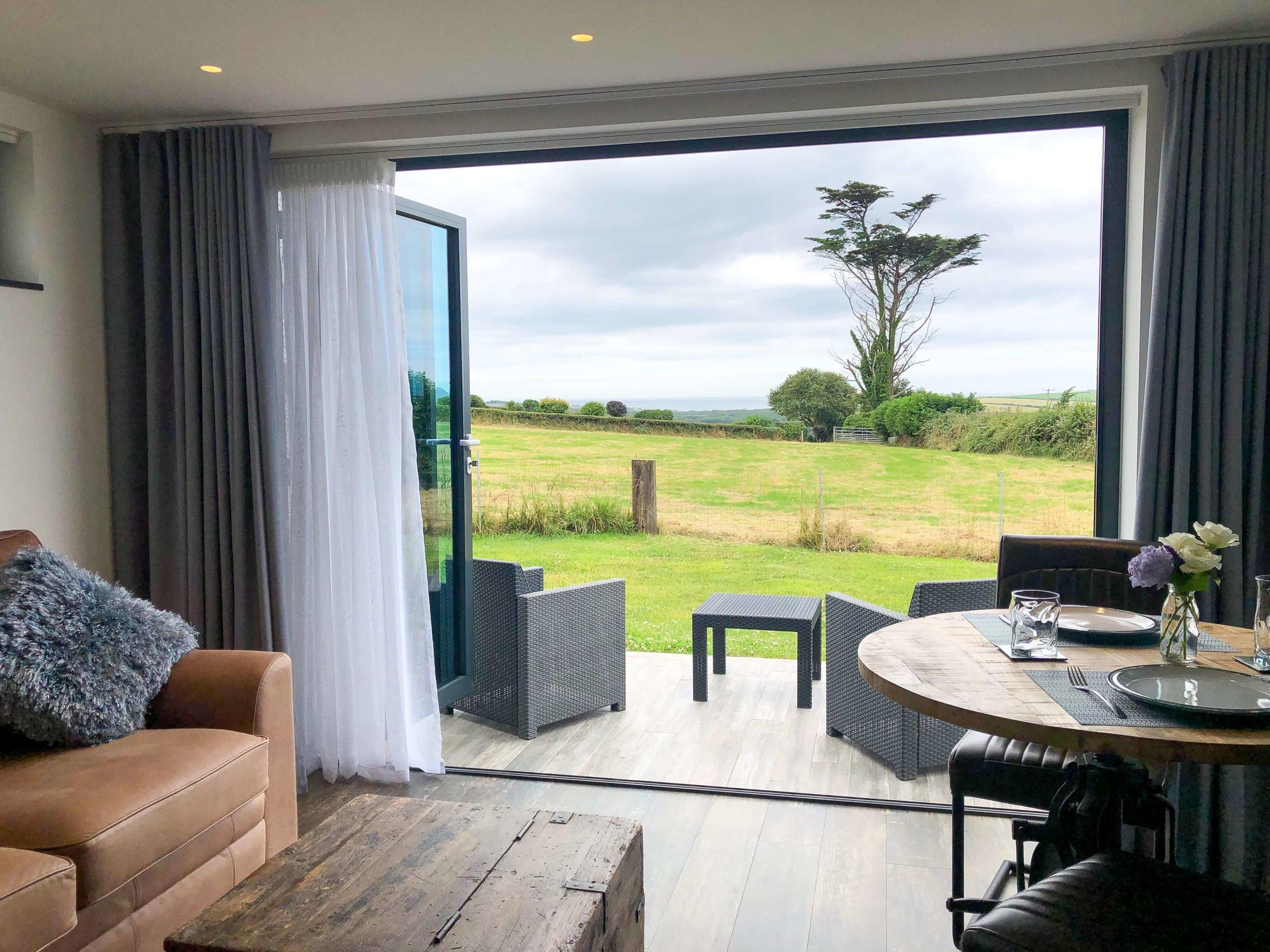 Bi-fold doors with countryside and sea views towards Widemouth Bay, Bude