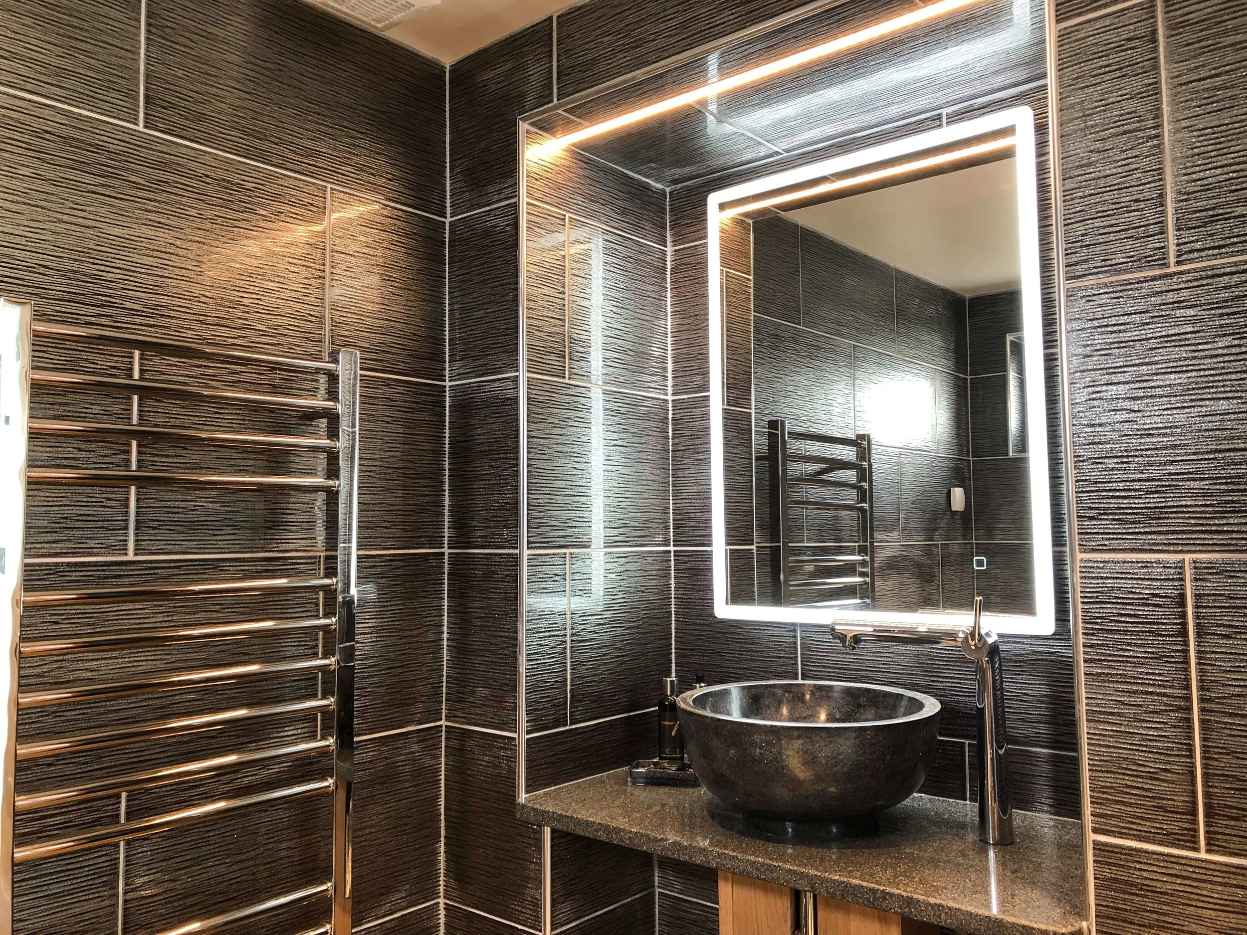 En-suite bathroom stone sink