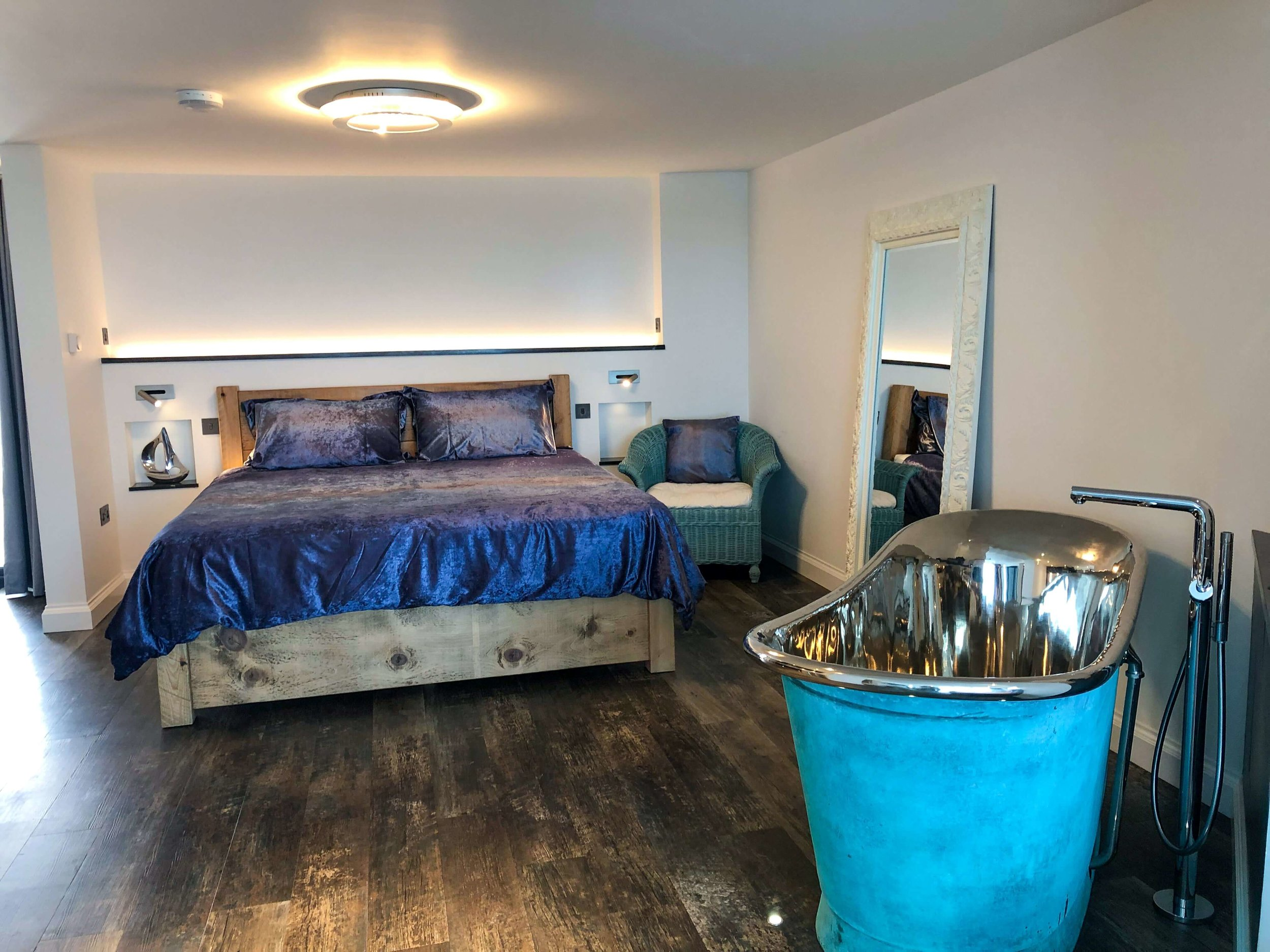 Open plan bedroom with super-king size bed and memory foam mattress