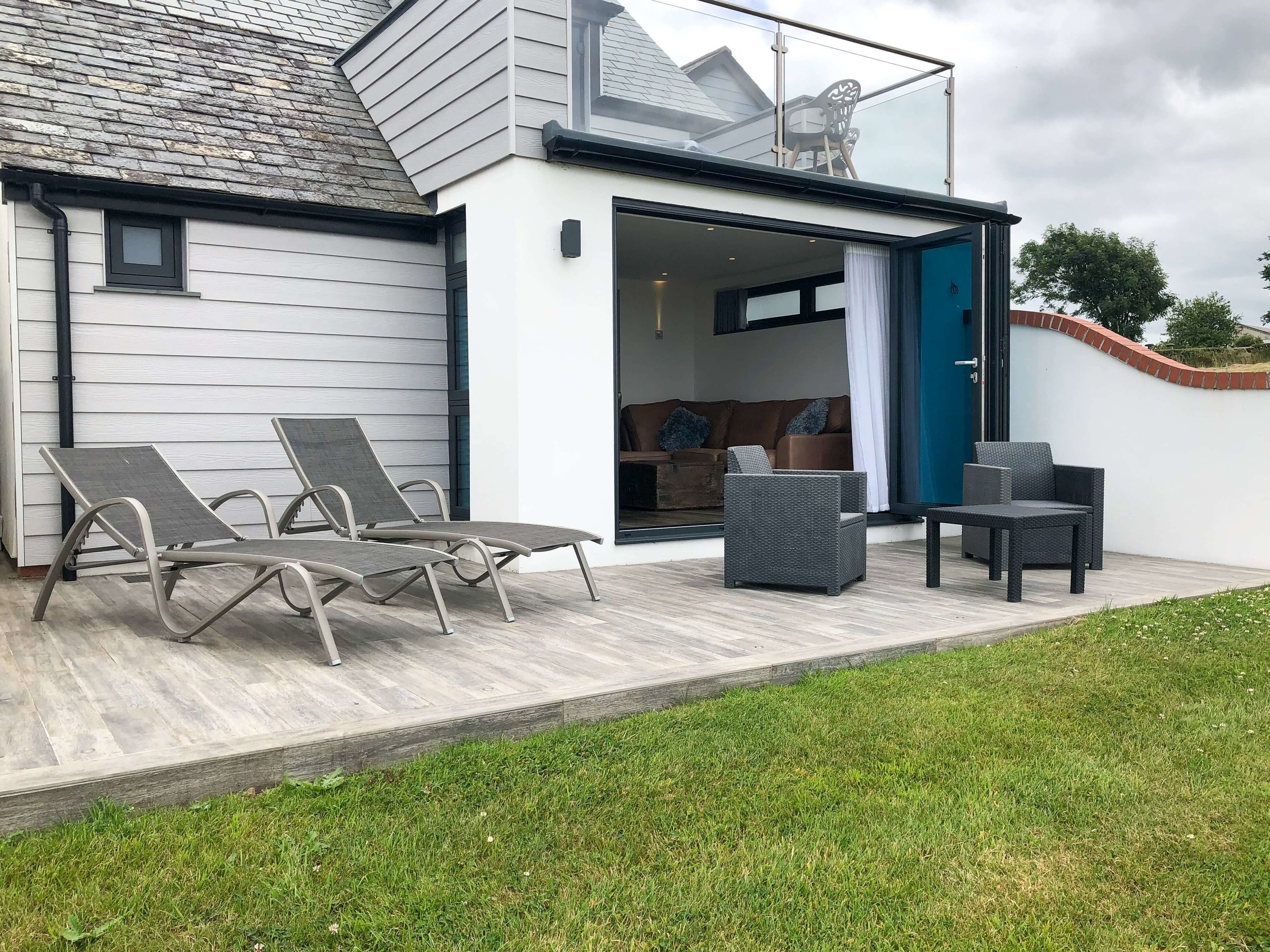 Patio/Deck area with sun loungers and seating for two persons