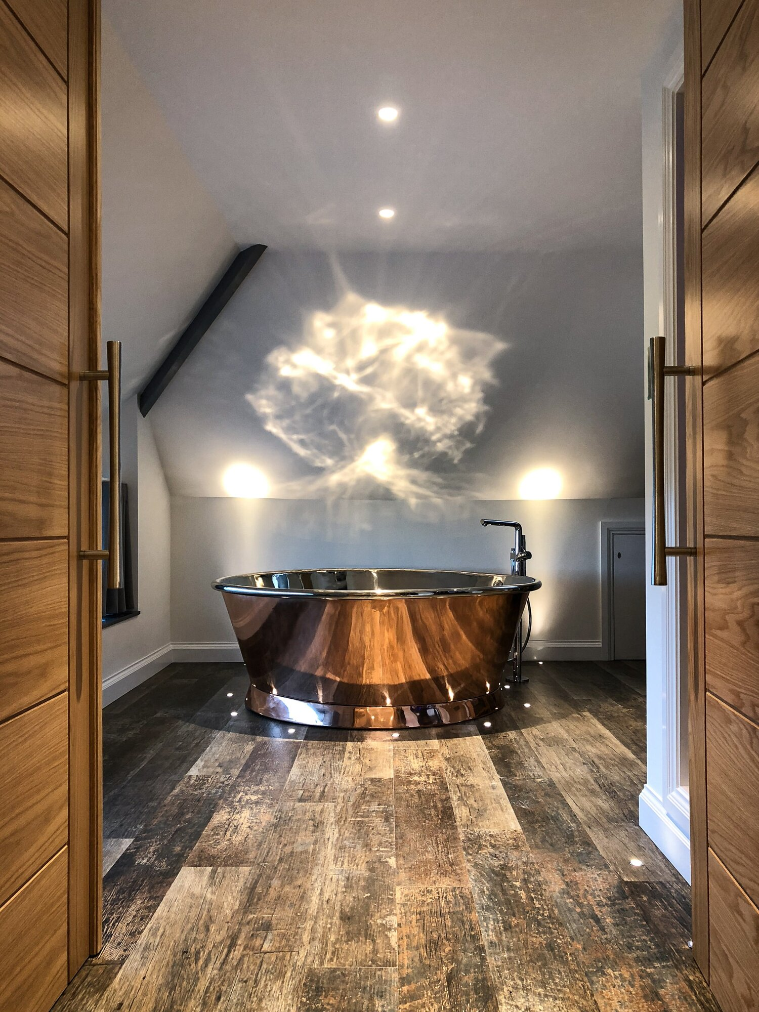 Copper air-spa freestanding bath tub with feature spot lighting