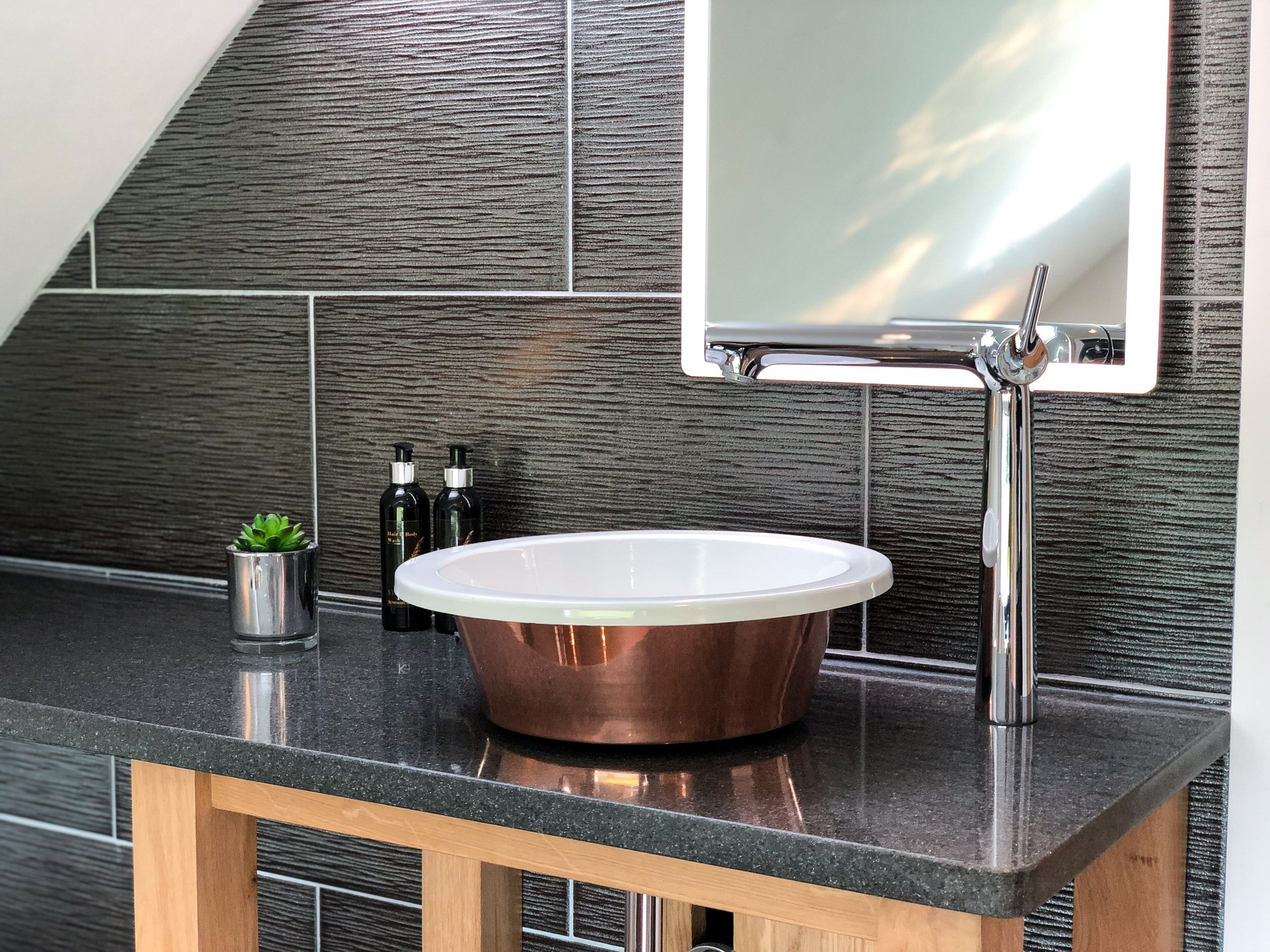 Copper and enamel sink with LED mirror
