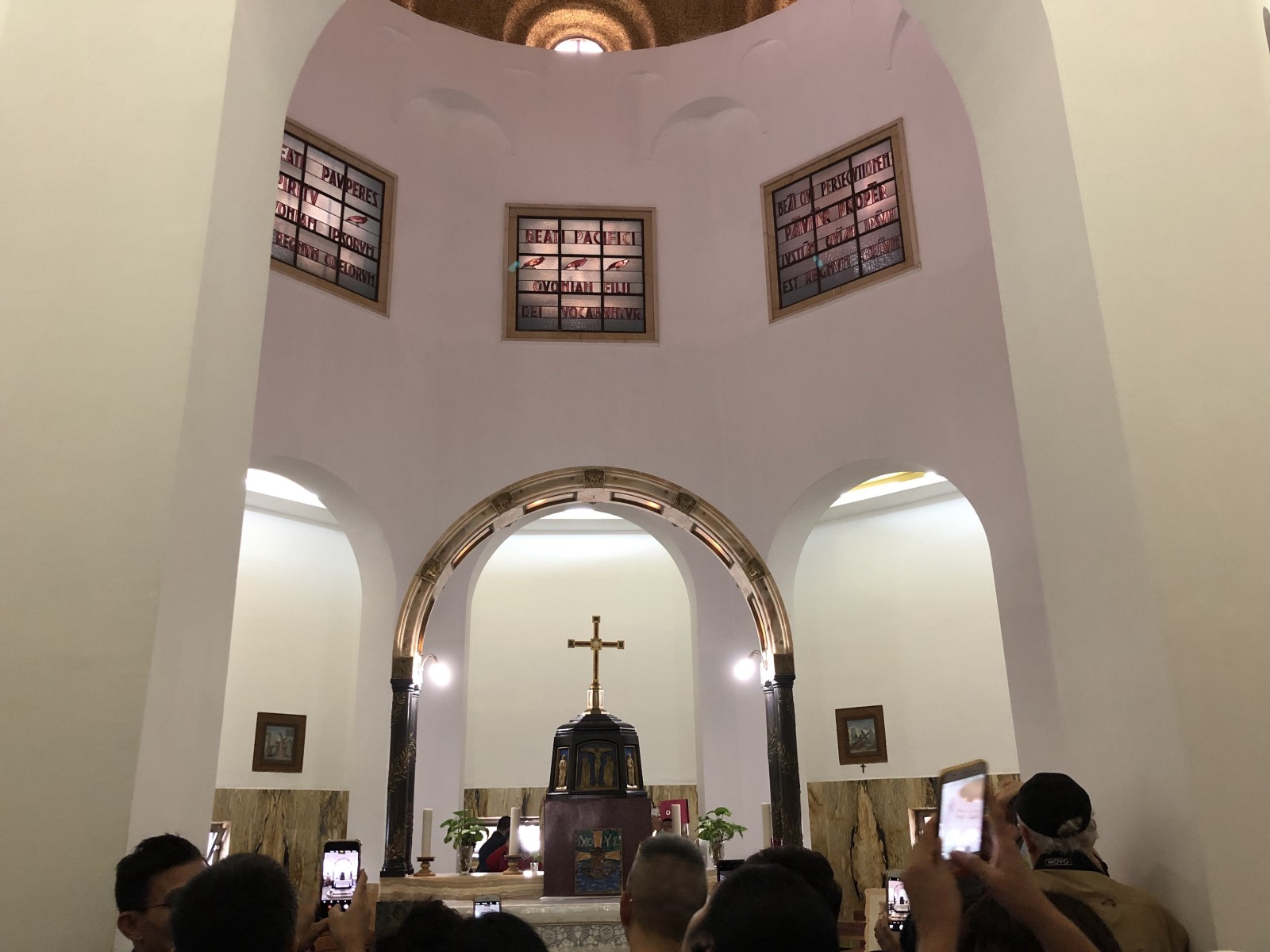 Notice all the phones taking a picture of the altar